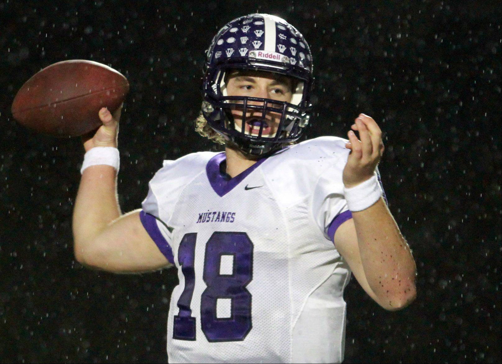 Rolling Meadows quarterback Bobby Suchecki throws the ball.