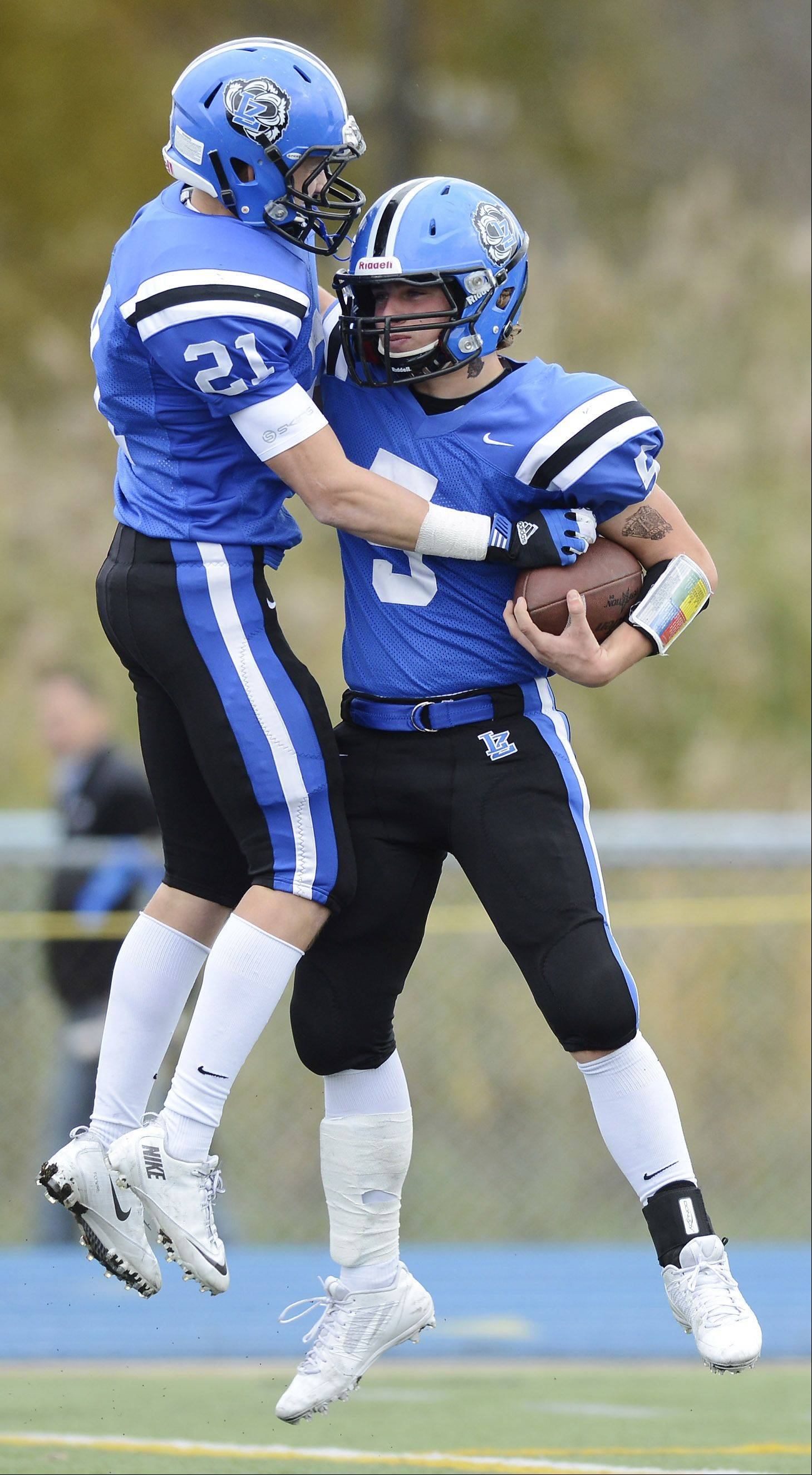 Lake Zurich's Sam Walstrum, right, celebrates his third-quarter touchdown with teammate Dylan Schassler during Saturday's Class 7A playoff game against Elk Grove.
