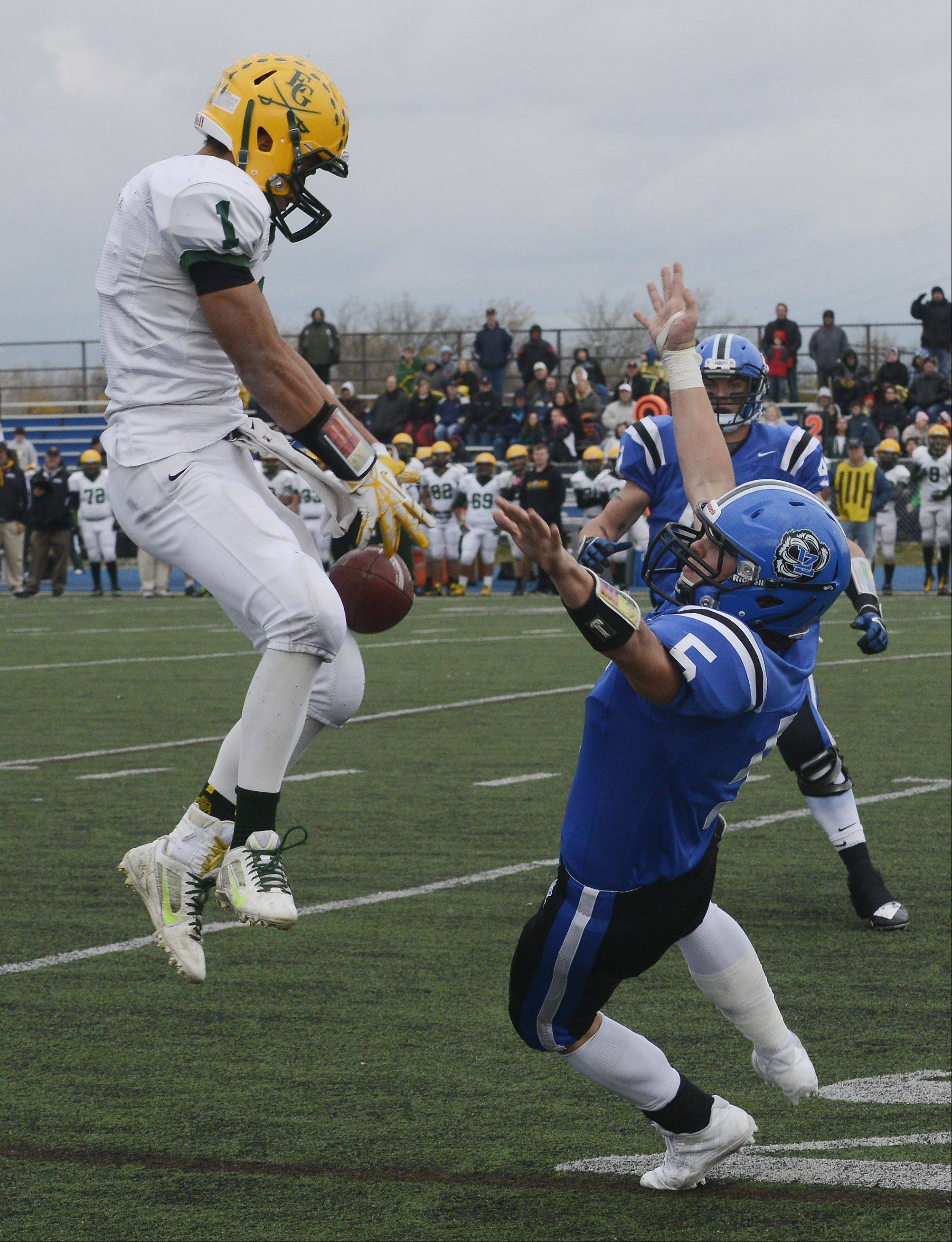 Elk Grove's John Pass, left, can't hang onto a pass but prevents an interception by Lake Zurich's Sam Walstrum during Saturday's Class 7A playoff game.