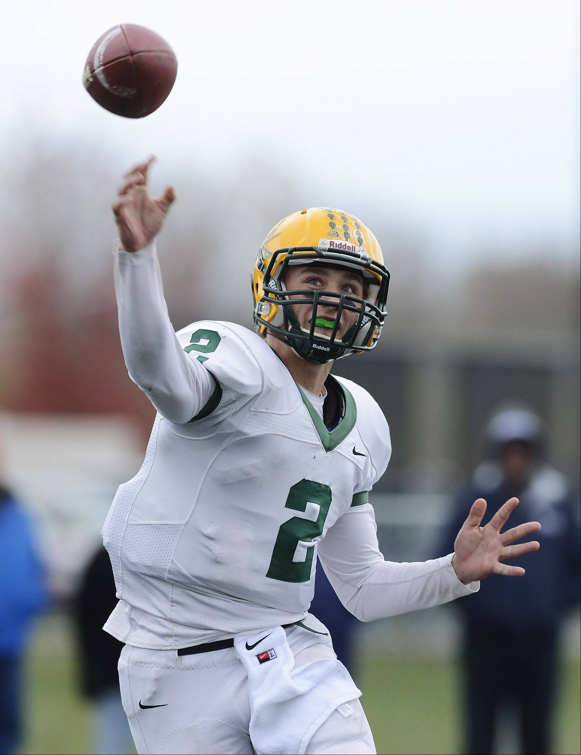 Elk Grove quarterback Adam O'Malley delivers a pass during Saturday's Class 7A playoff game against Lake Zurich.