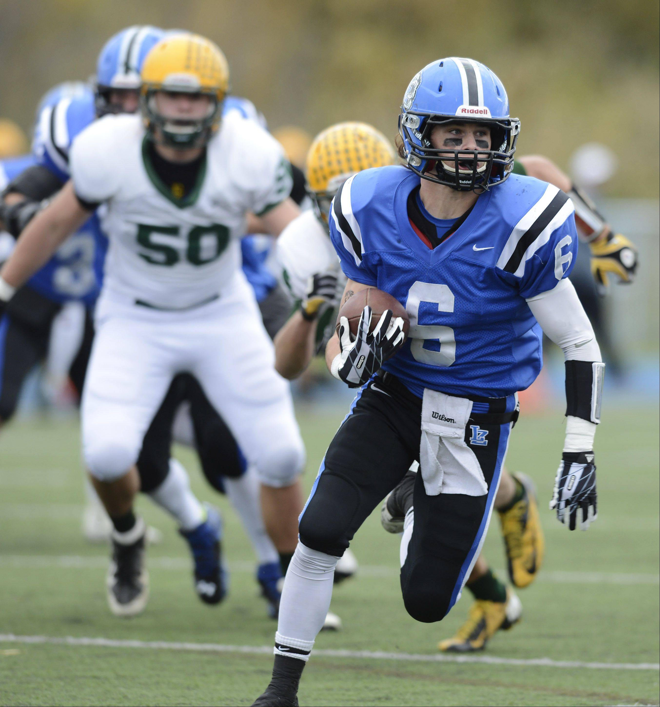 Lake Zurich's Sean Lynch carries the ball during Saturday's Class 7A playoff game against Elk Grove.