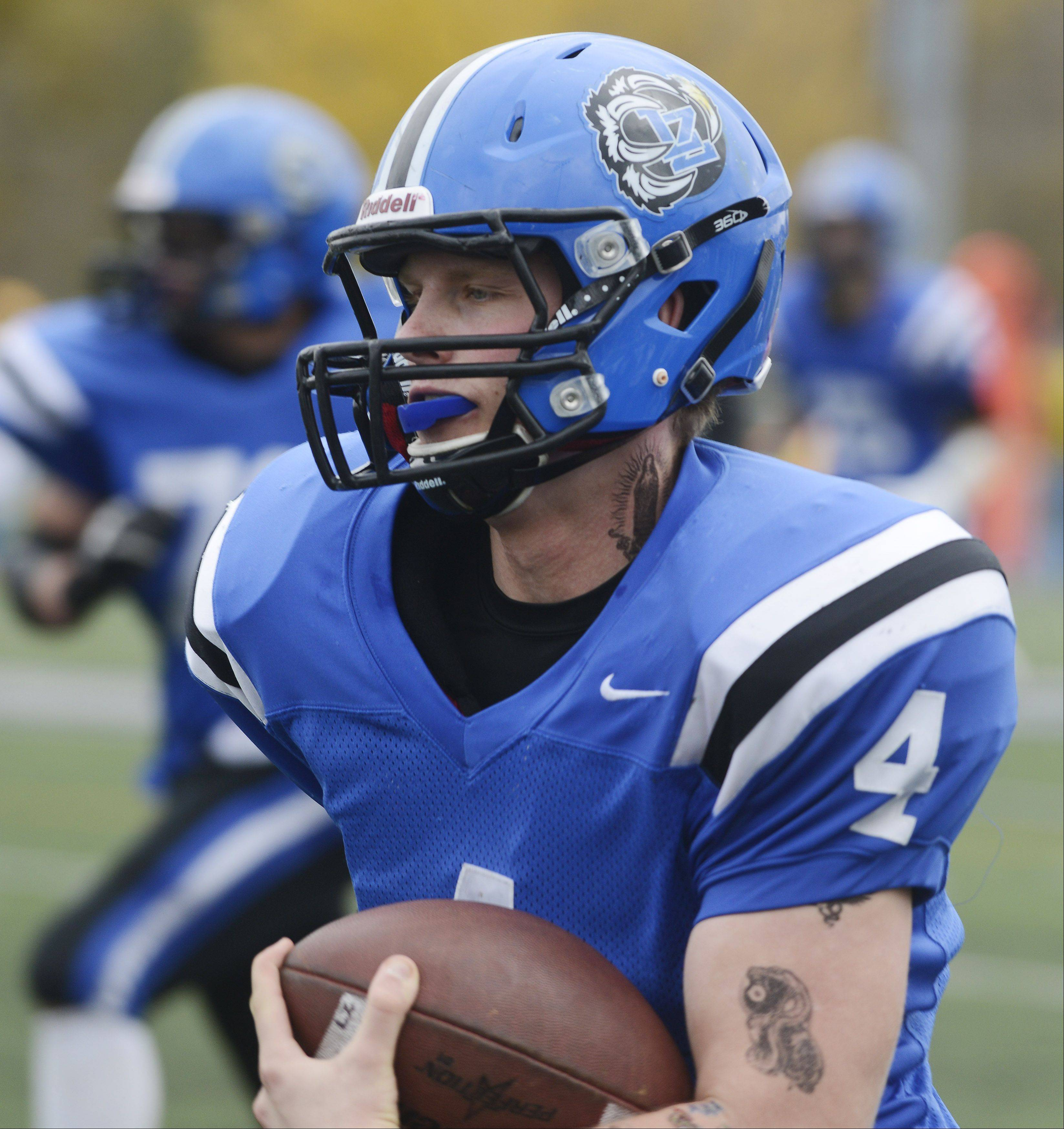 Lake Zurich's Noah Allgood carries the ball for a touchdown against Elk Grove during Saturday's Class 7A playoff game.