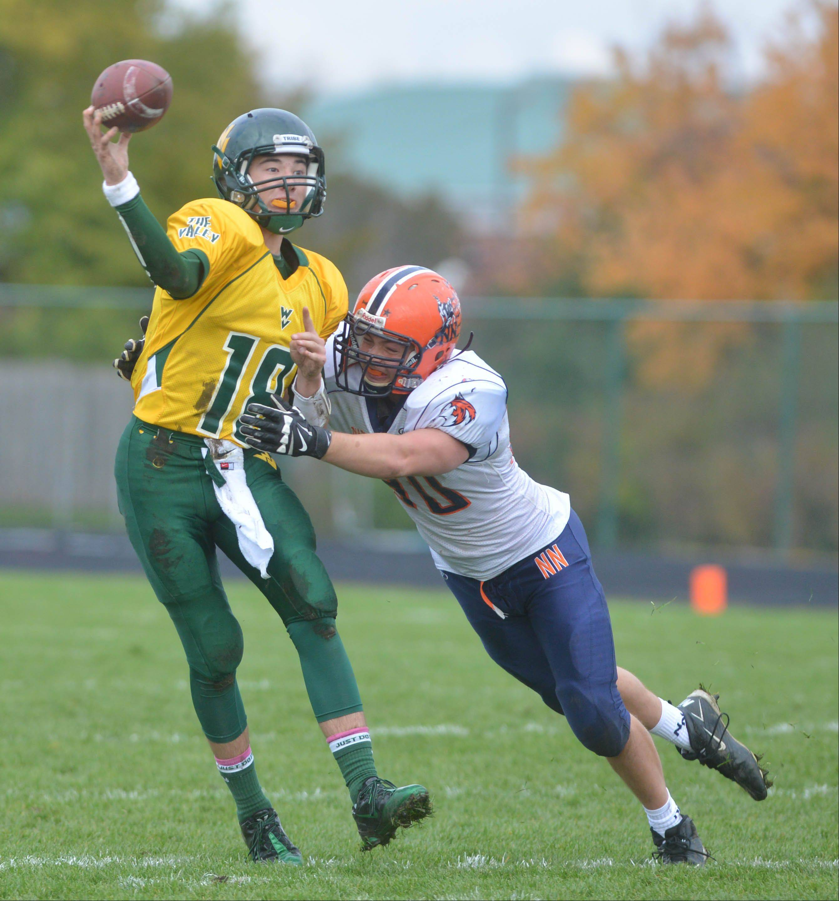 Jack Eddy of Waubonsie Valley throws a pass against Naperville North Saturday.