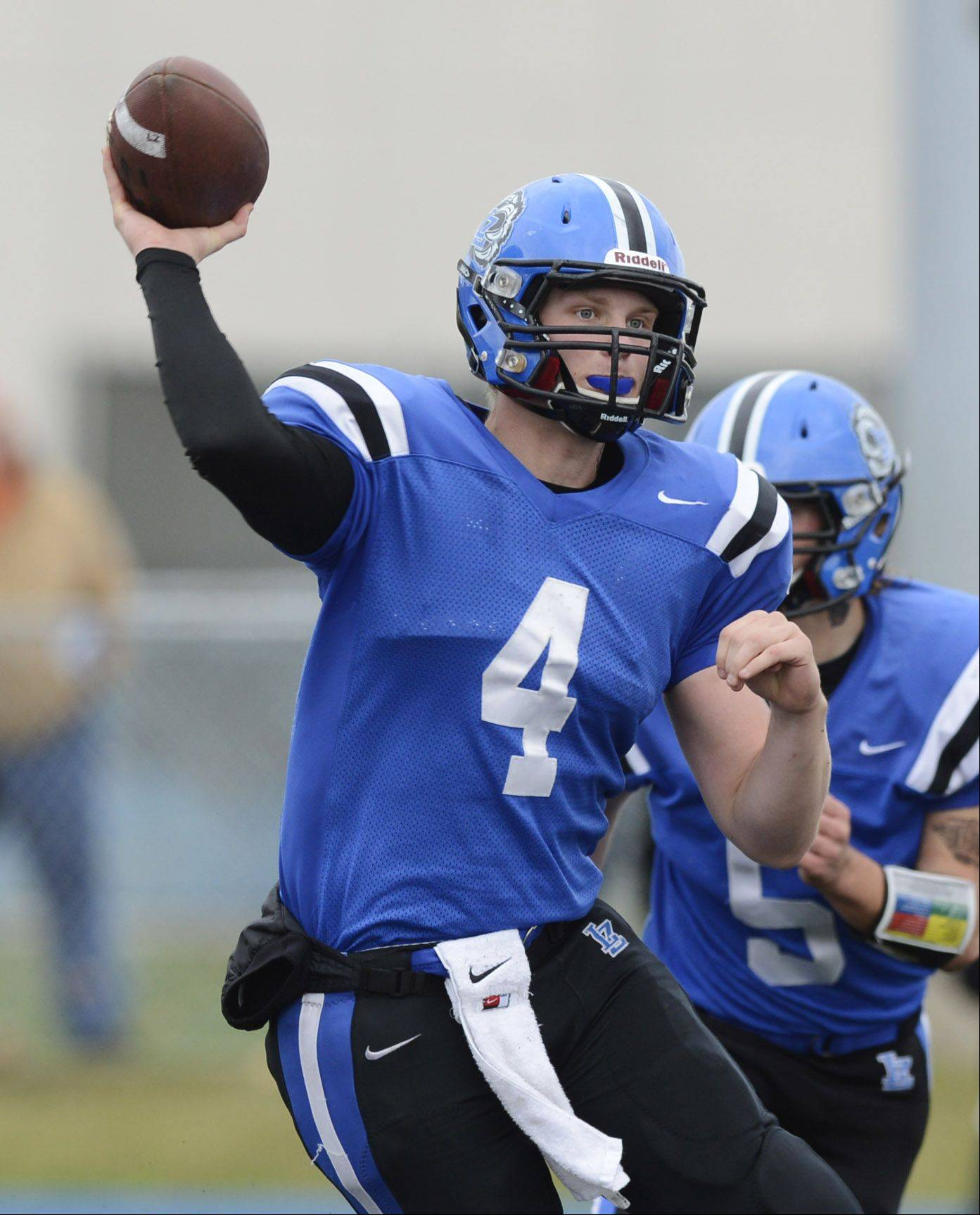 Lake Zurich quarterback Noah Allgood throws a pass during Saturday's class 7A playoff game against Elk Grove.
