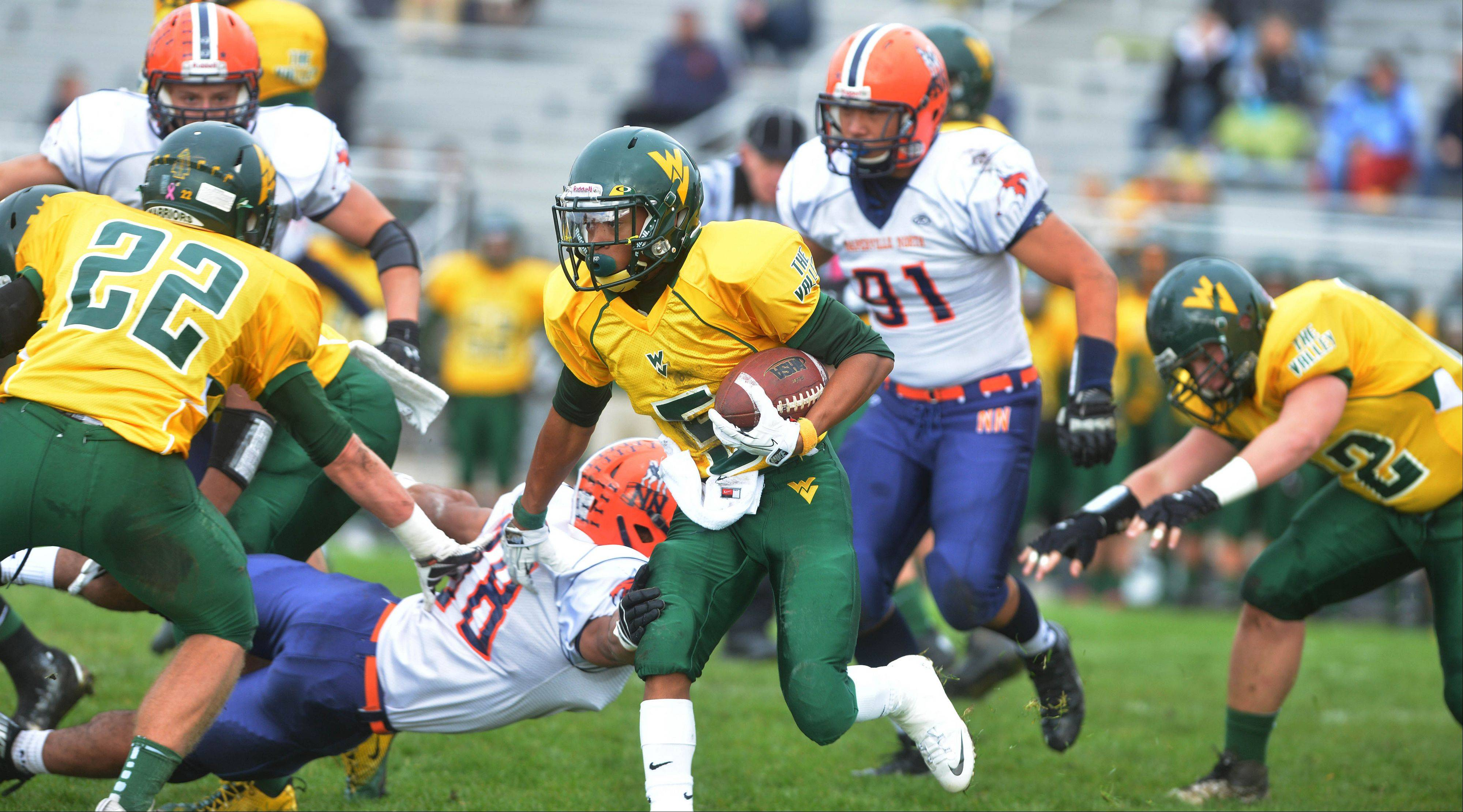 Devin Strickland of Waubonsie is on the run during the Naperville North at Waubonsie Valley football playoff opener Saturday.