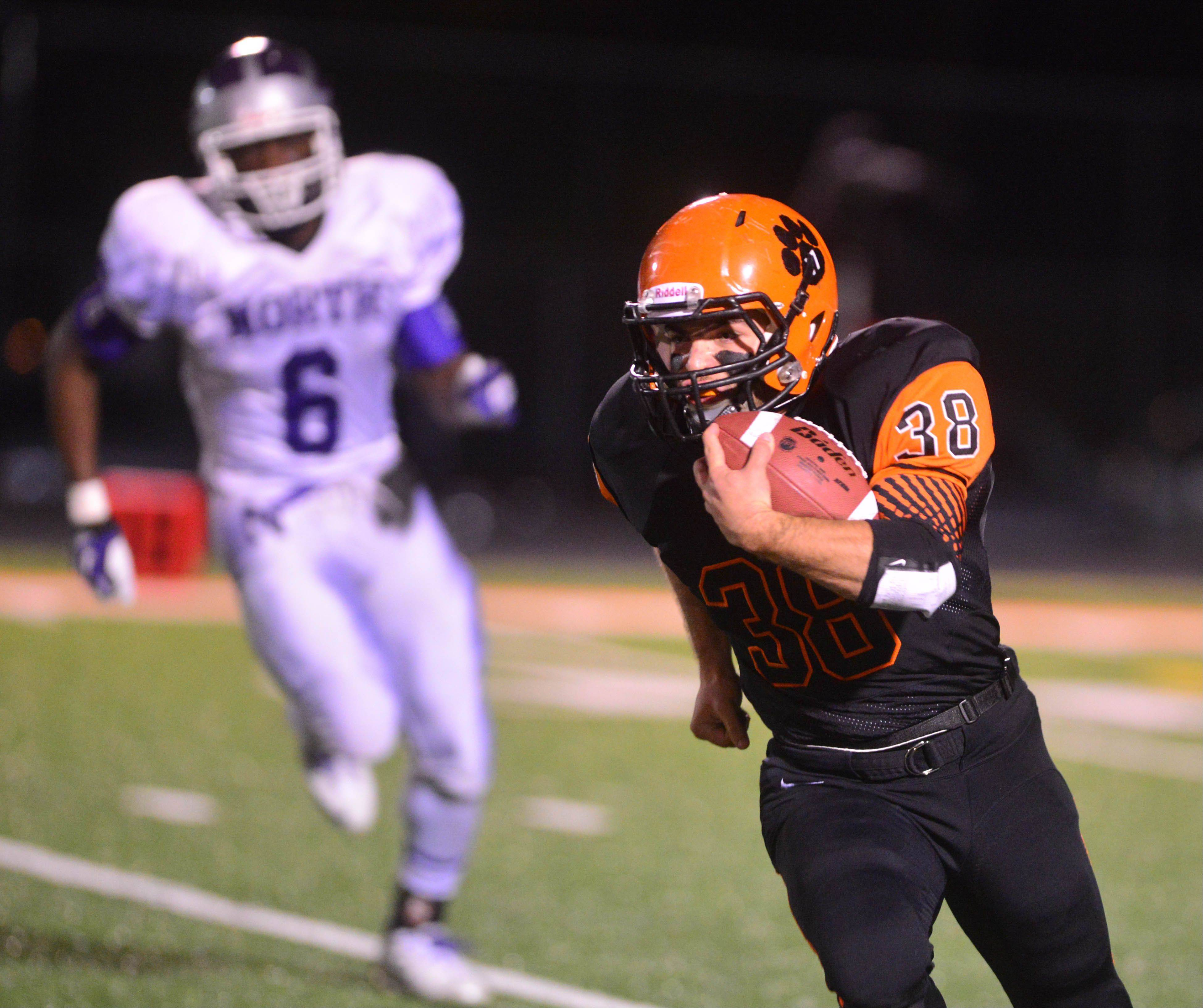 Zack Moberg of Wheaton Warrenville south runs the ball.