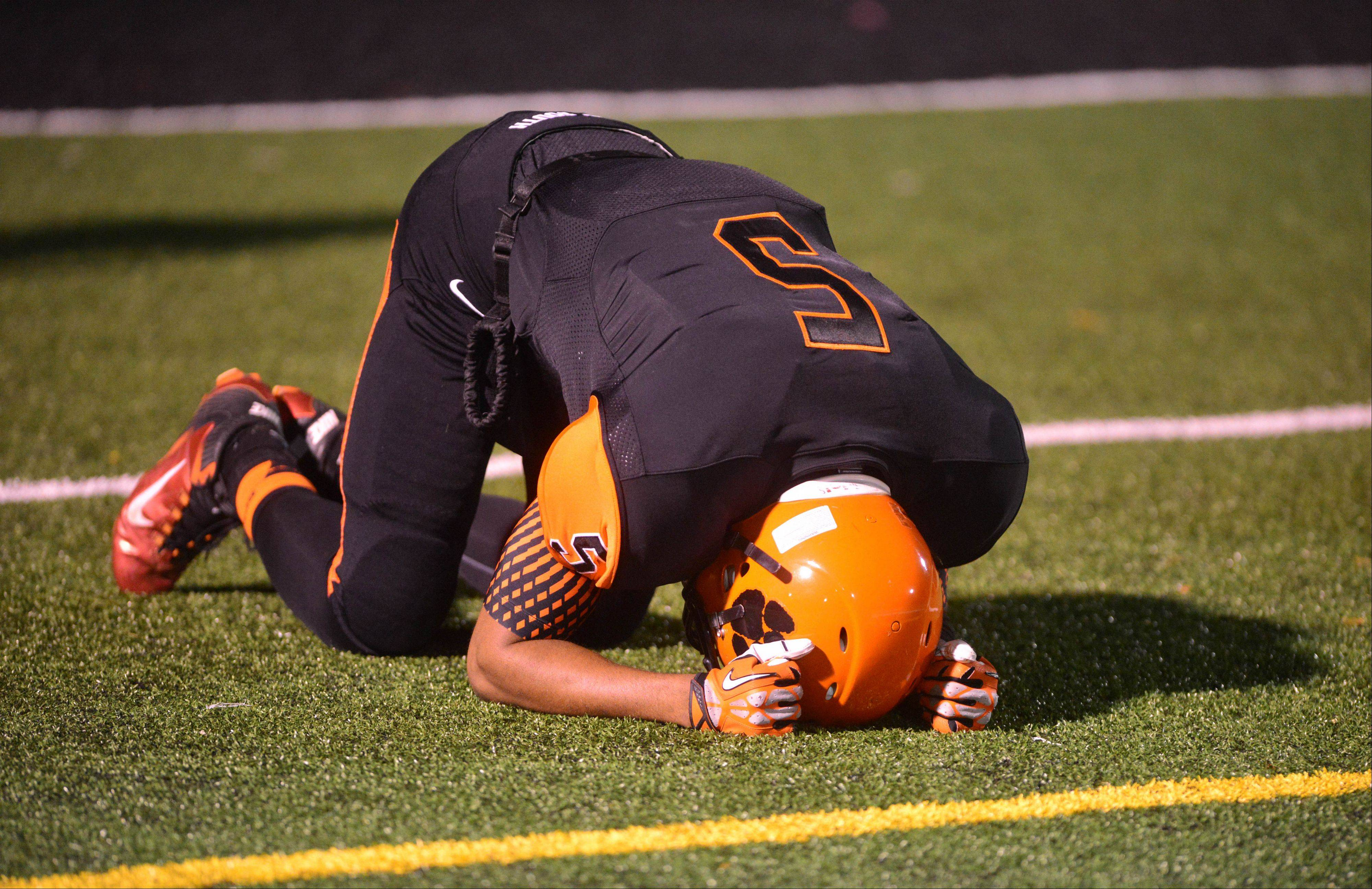 Savone Carter of Wheaton Warrenville South reacts.