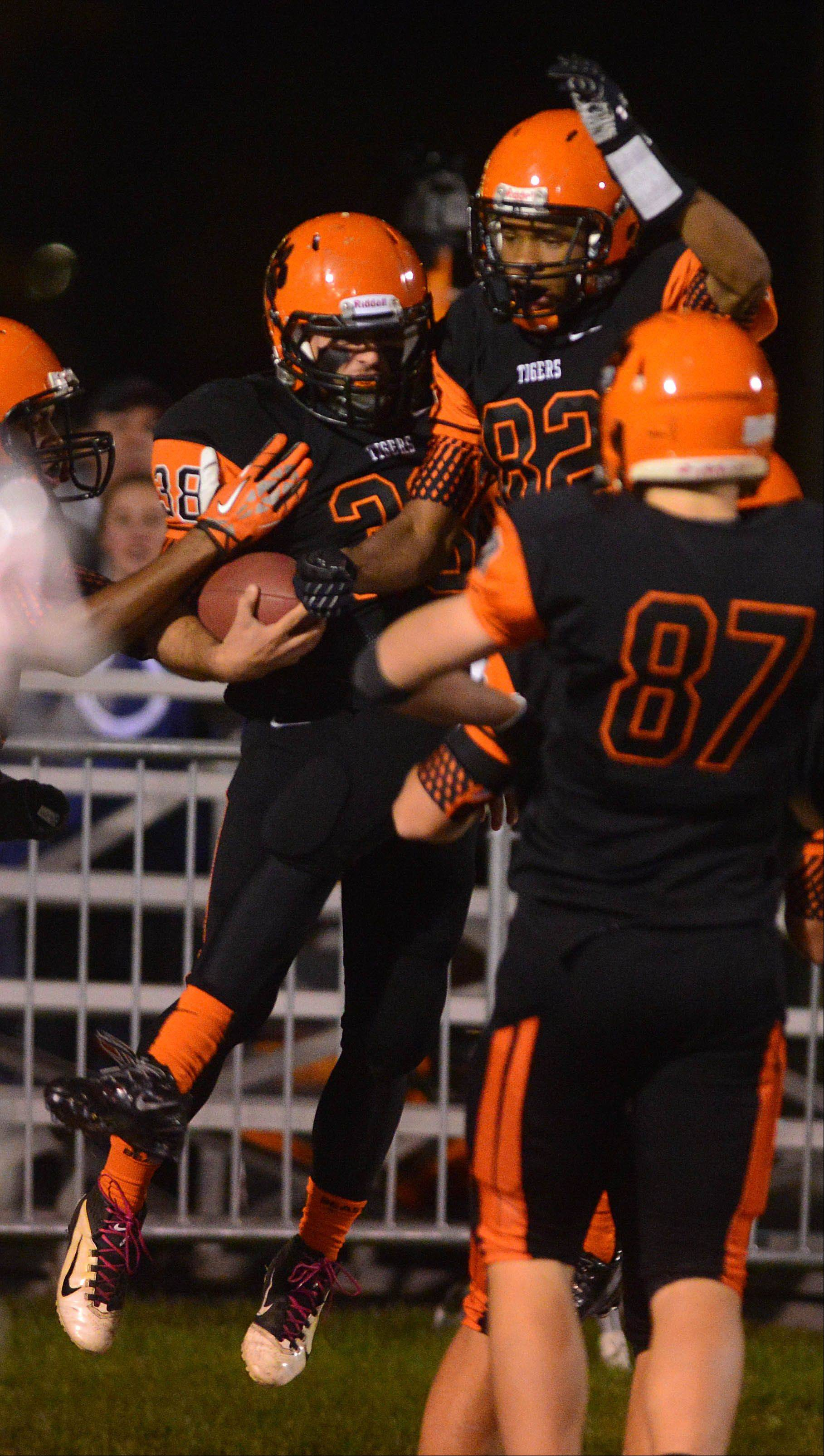 Zack Moberg,left, and Keishawn Watson celebrate a touchdown.