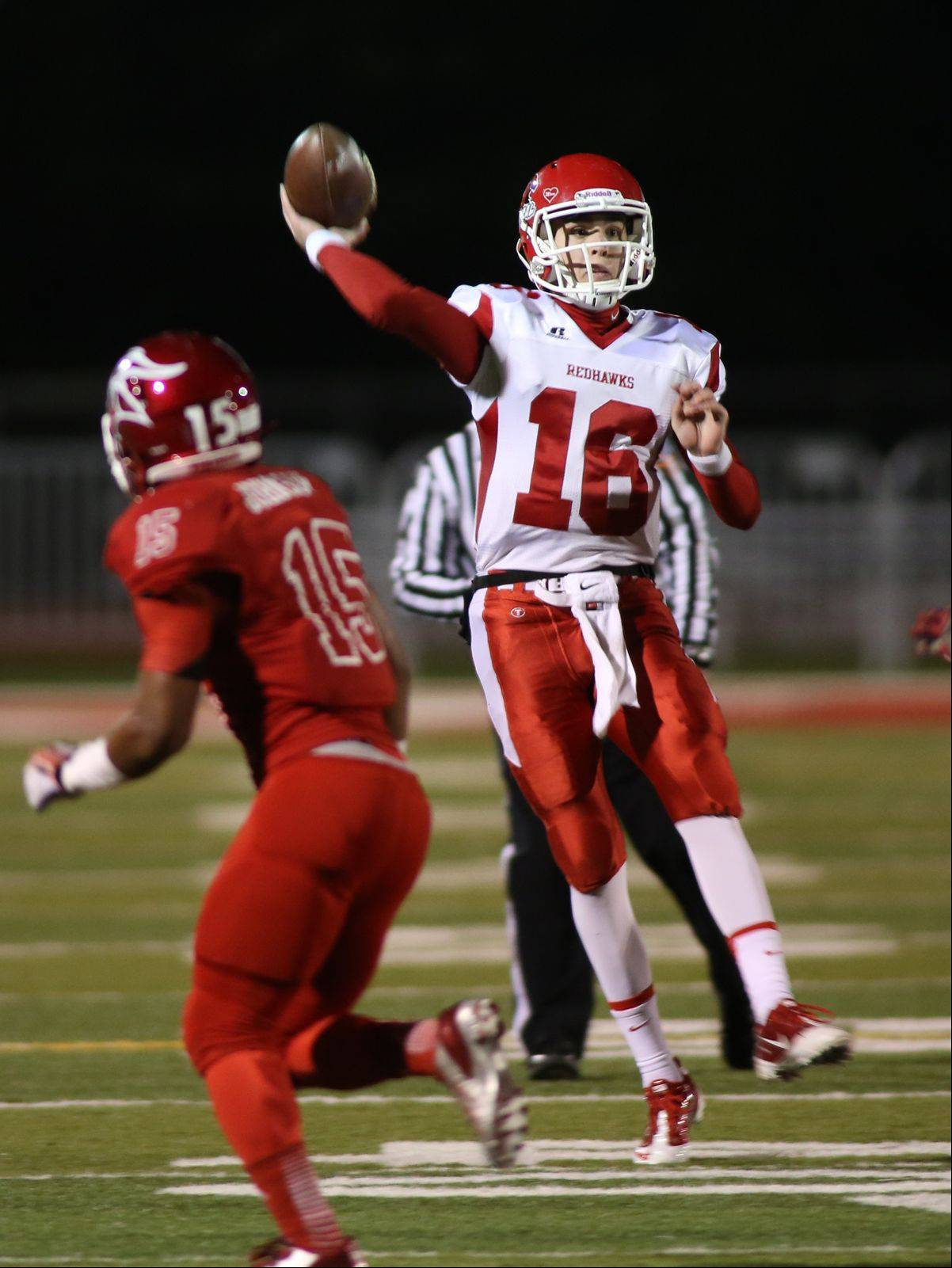 Naperville Central quarterback Jake Kolbe rolls out to pass.
