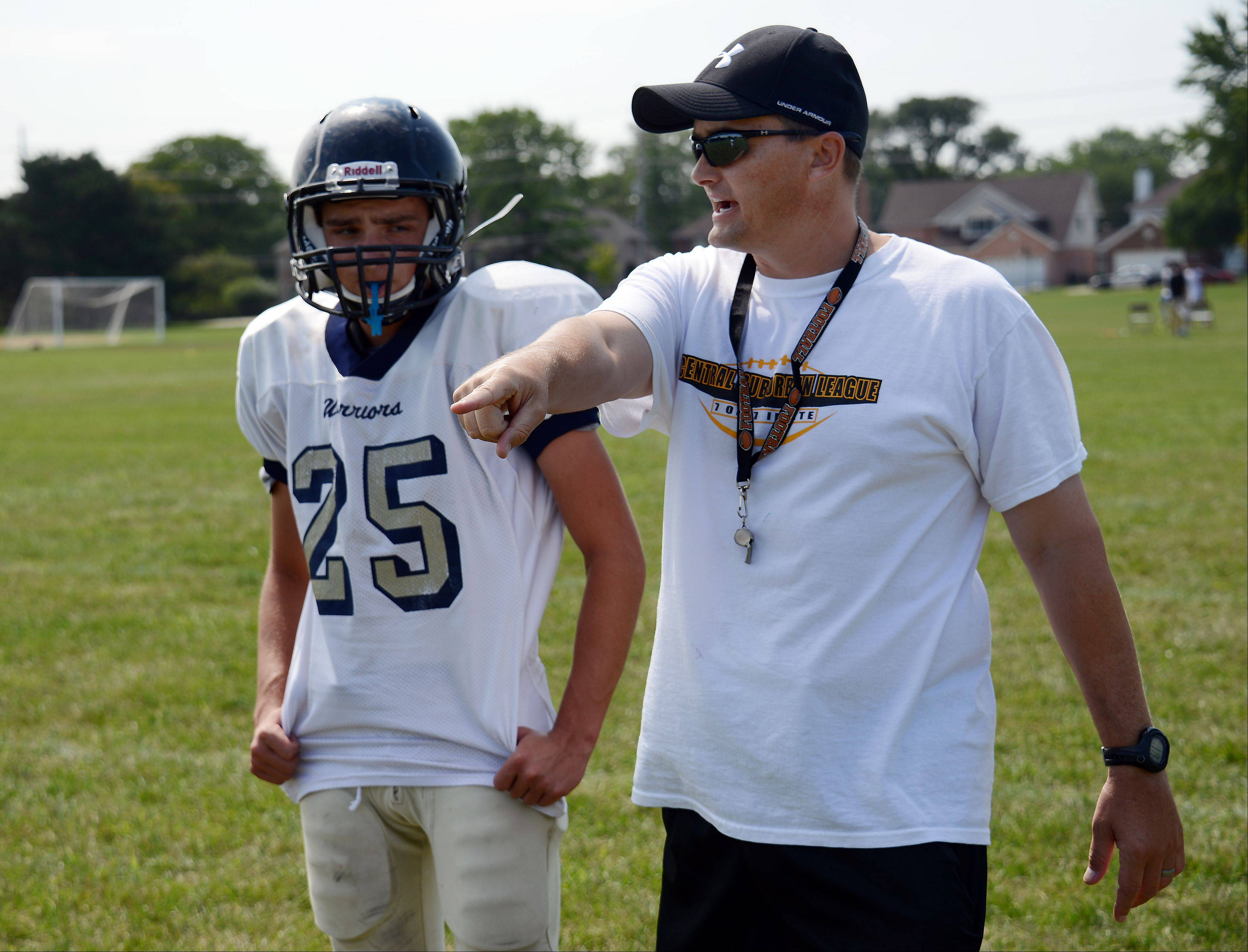 Maine West football coach Chris Hare, right, announced his resignation Friday.