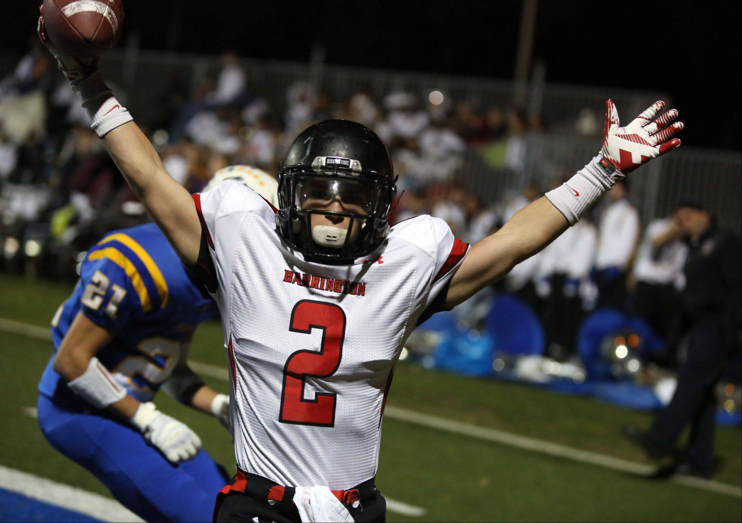 Barrington receiver Matt Moran celebrates a touchdown on a pass from quarterback Daniel Kubiuk with less than three minutes left Saturday against host Warren.