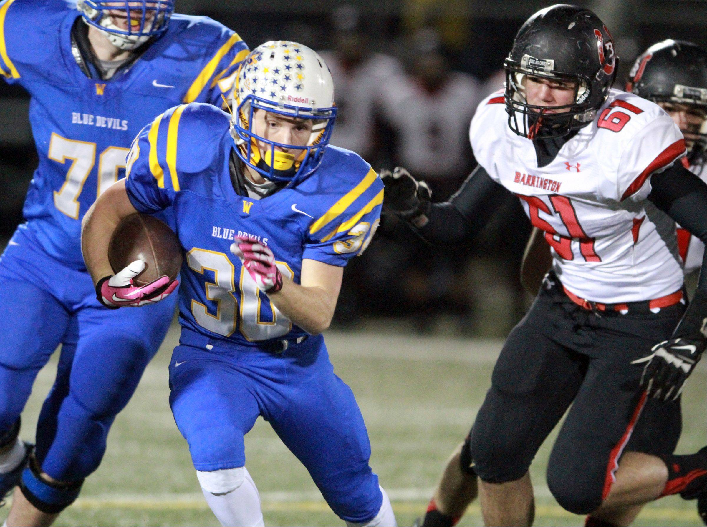 Warren running back Maxwell Sorby runs past Barrington defender Kyle Meckert in the first half Saturday in Gurnee.