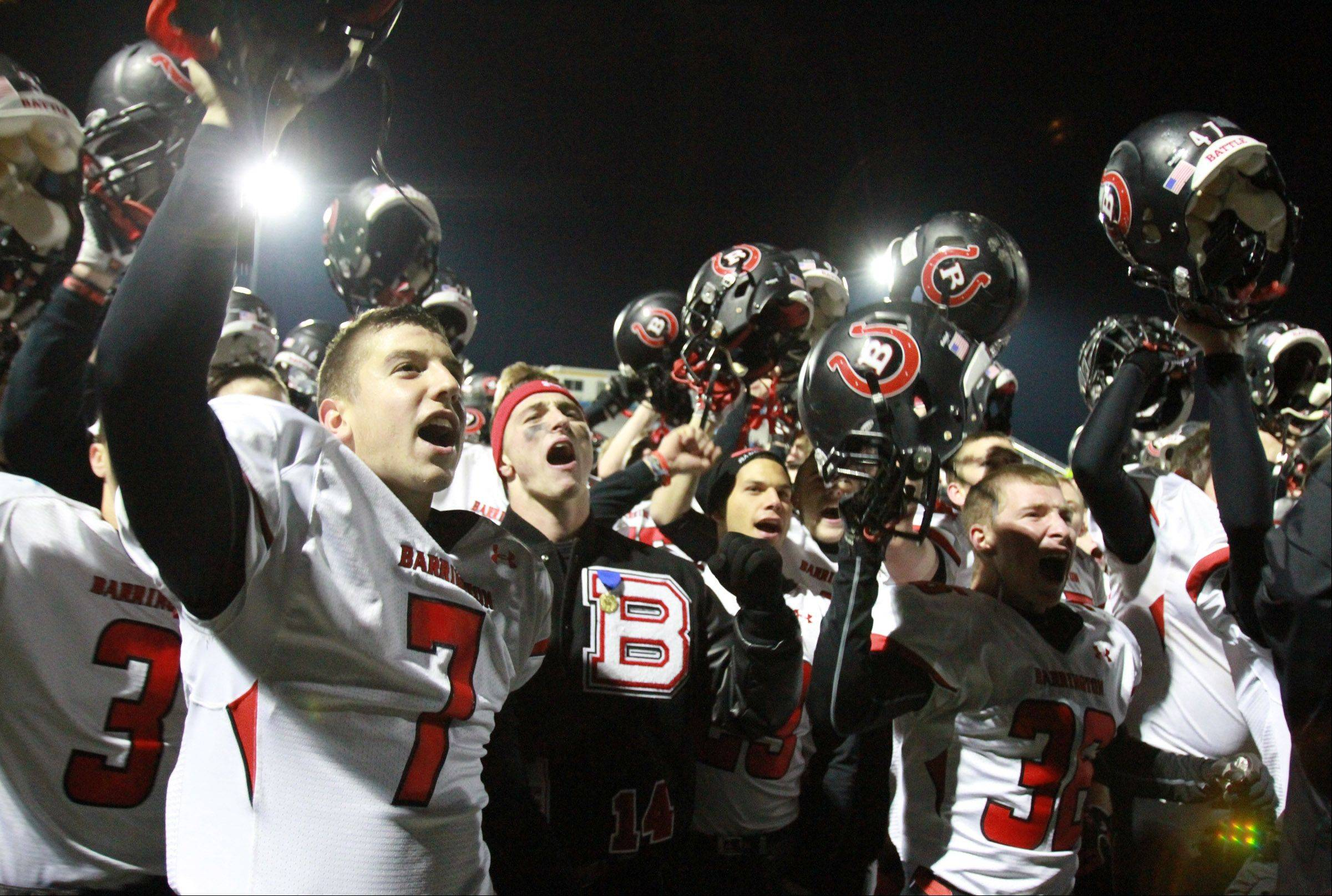 Barrington sings the school song in front of student fans after winning Saturday against Warren.