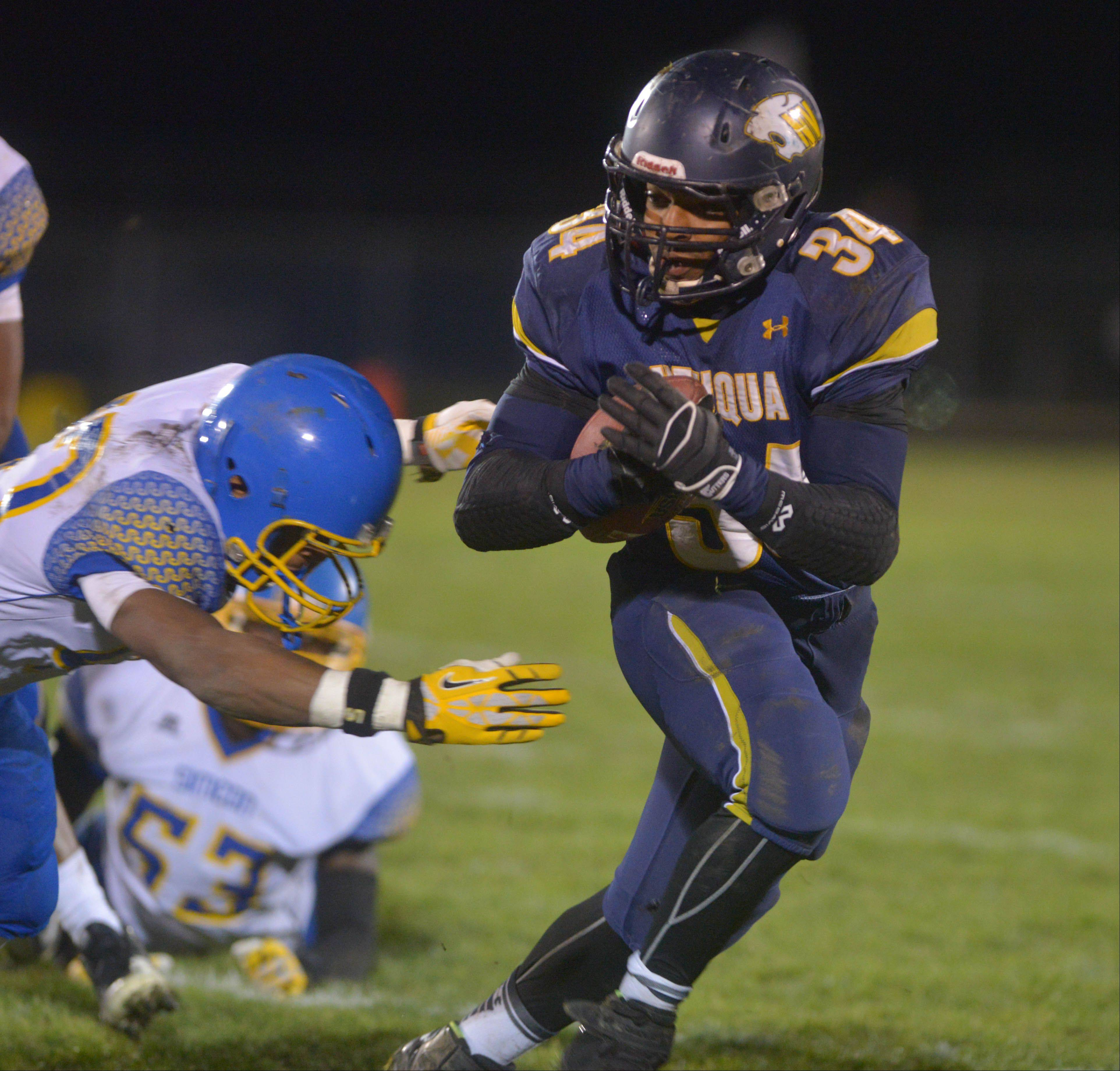 Neuqua Valley's TJ Scruggs picks up yardage against Simeon Saturday night during the Wildcats' Class 8A playoff win.