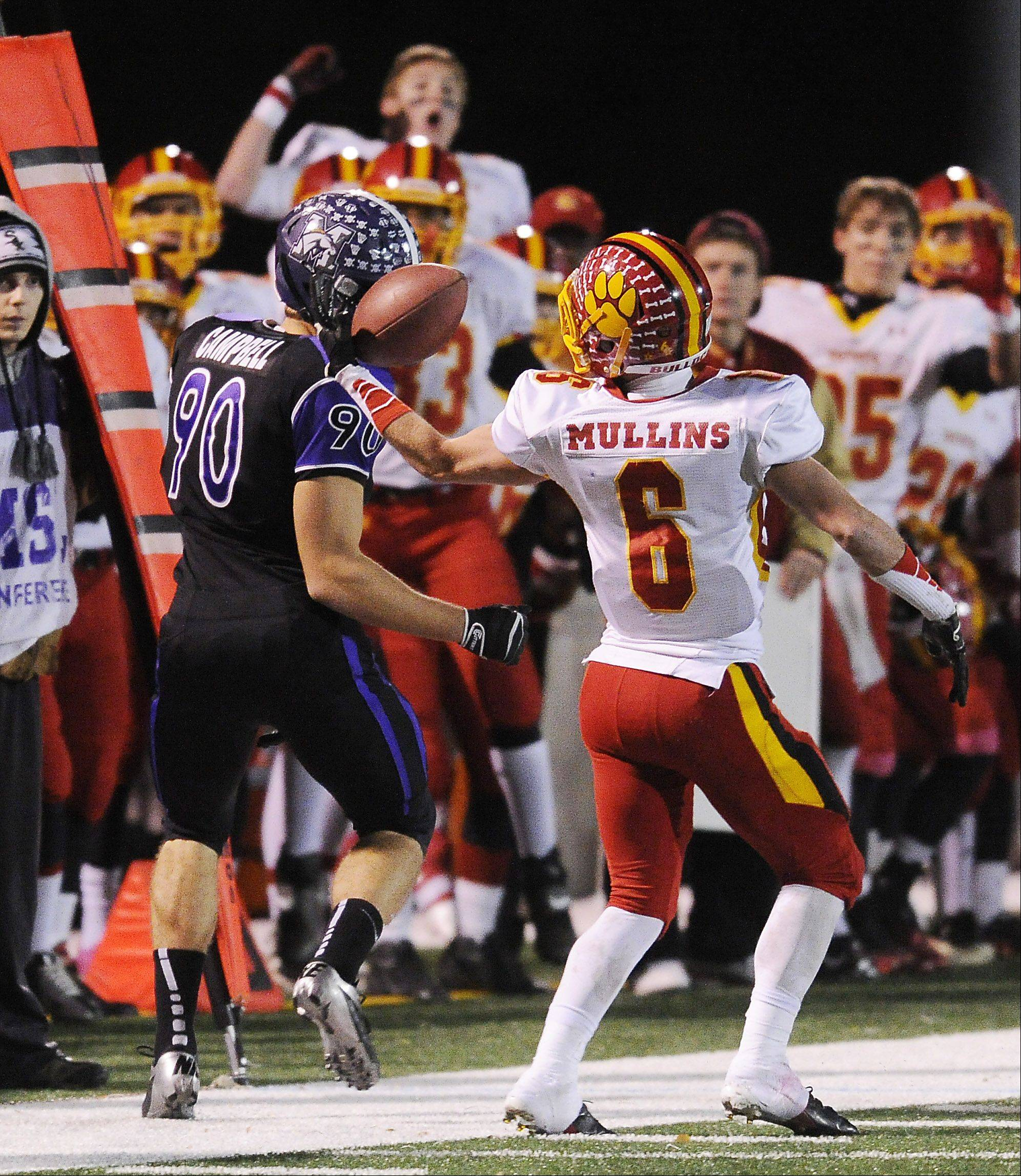 Batavia's Rouke Mullins takes the ball away from Rolling Meadows' Matt Campbell in the second quarter of Class 6A playoff action Saturday at Rolling Meadows.