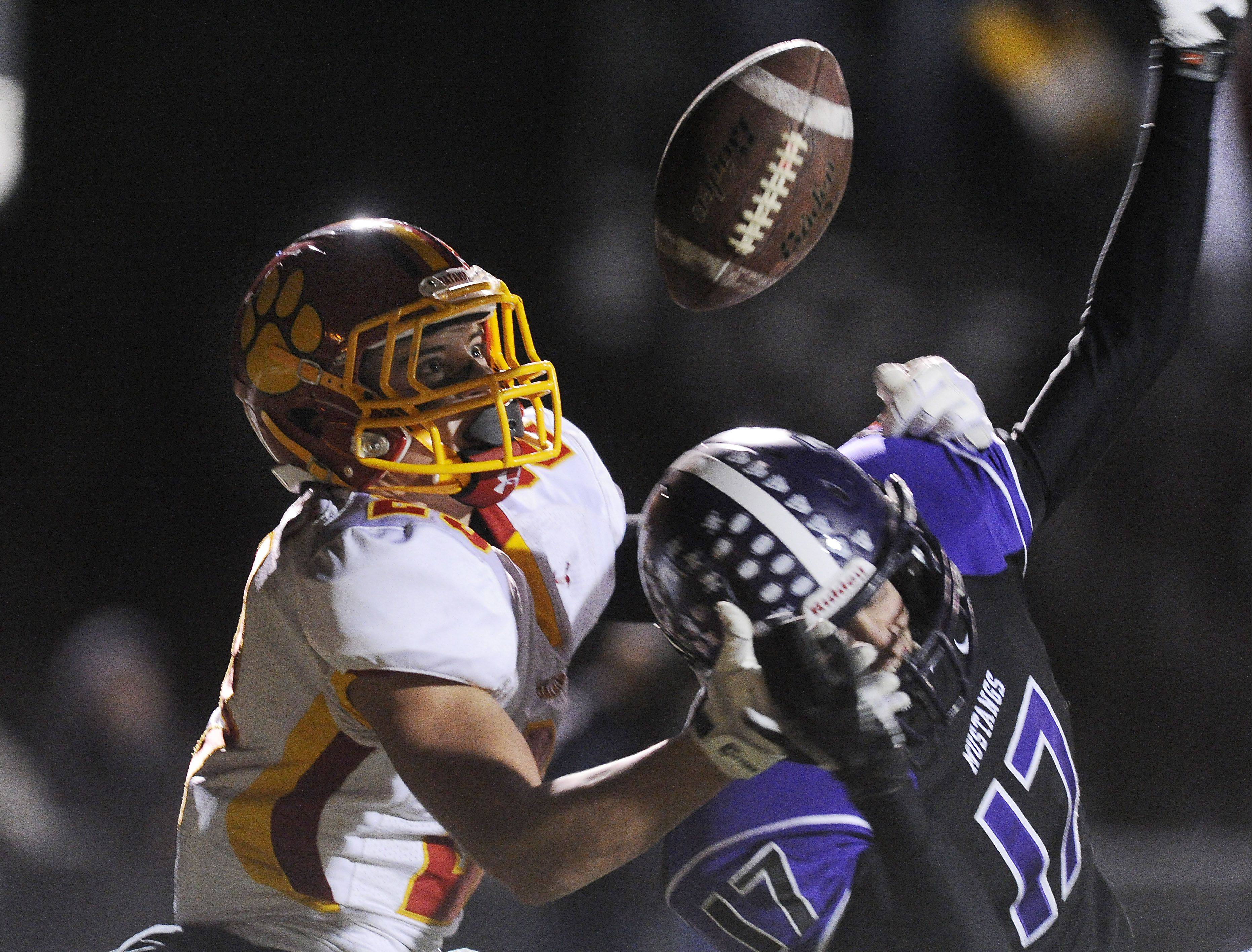 Batavia's Michael Moffatt keeps his eyes on the ball and hauls in a second-quarter touchdown over Rolling Meadows' Kevin Adair on Saturday at Rolling Meadows.