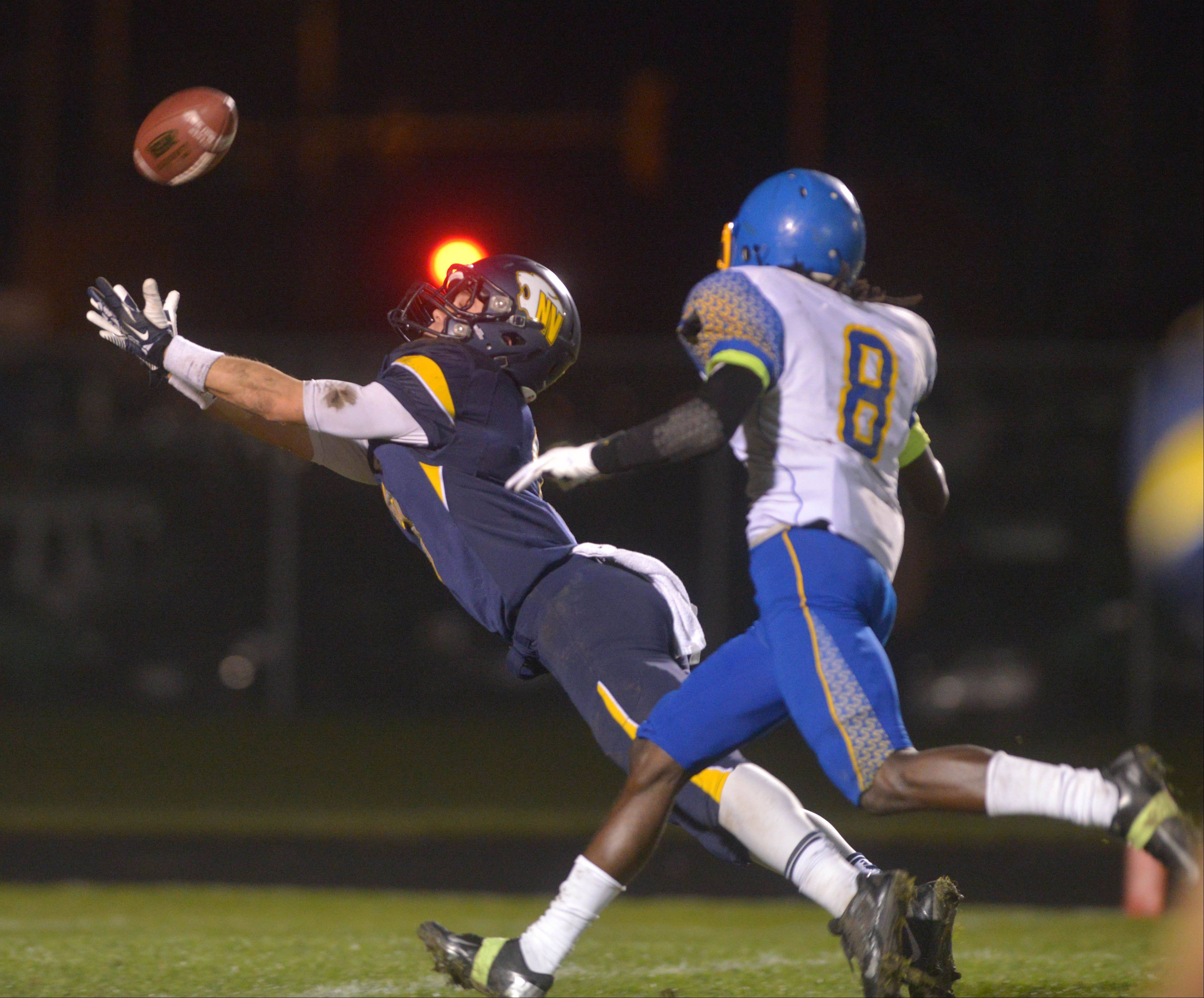 Neuqua Valley's Mikey Dudek reaches for the ball during Saturday's playoff game against Simeon.
