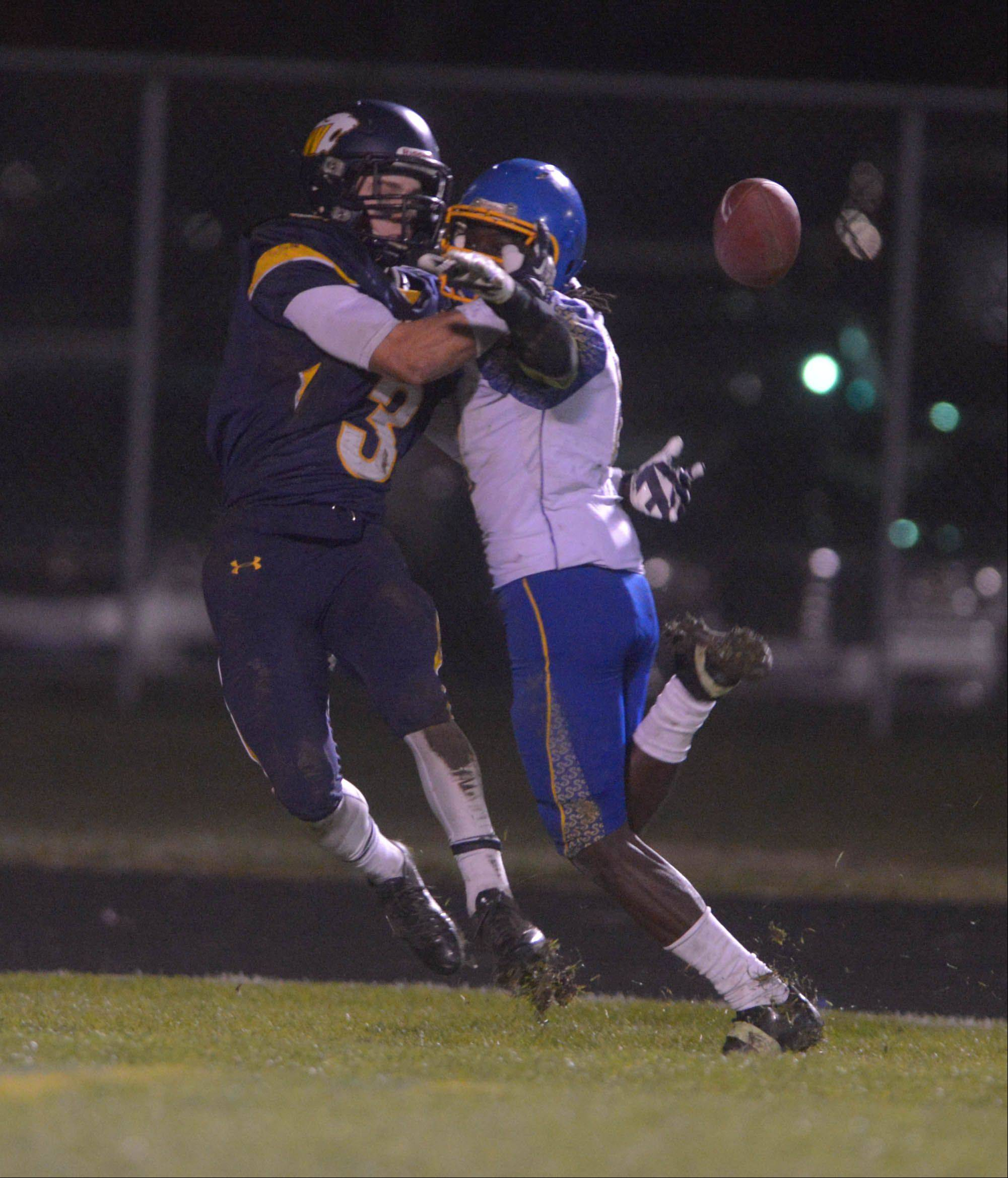 Neuqua Valley's Mikey Dudek tries to make a catch under pressure during Saturday's playoff game in Naperville.