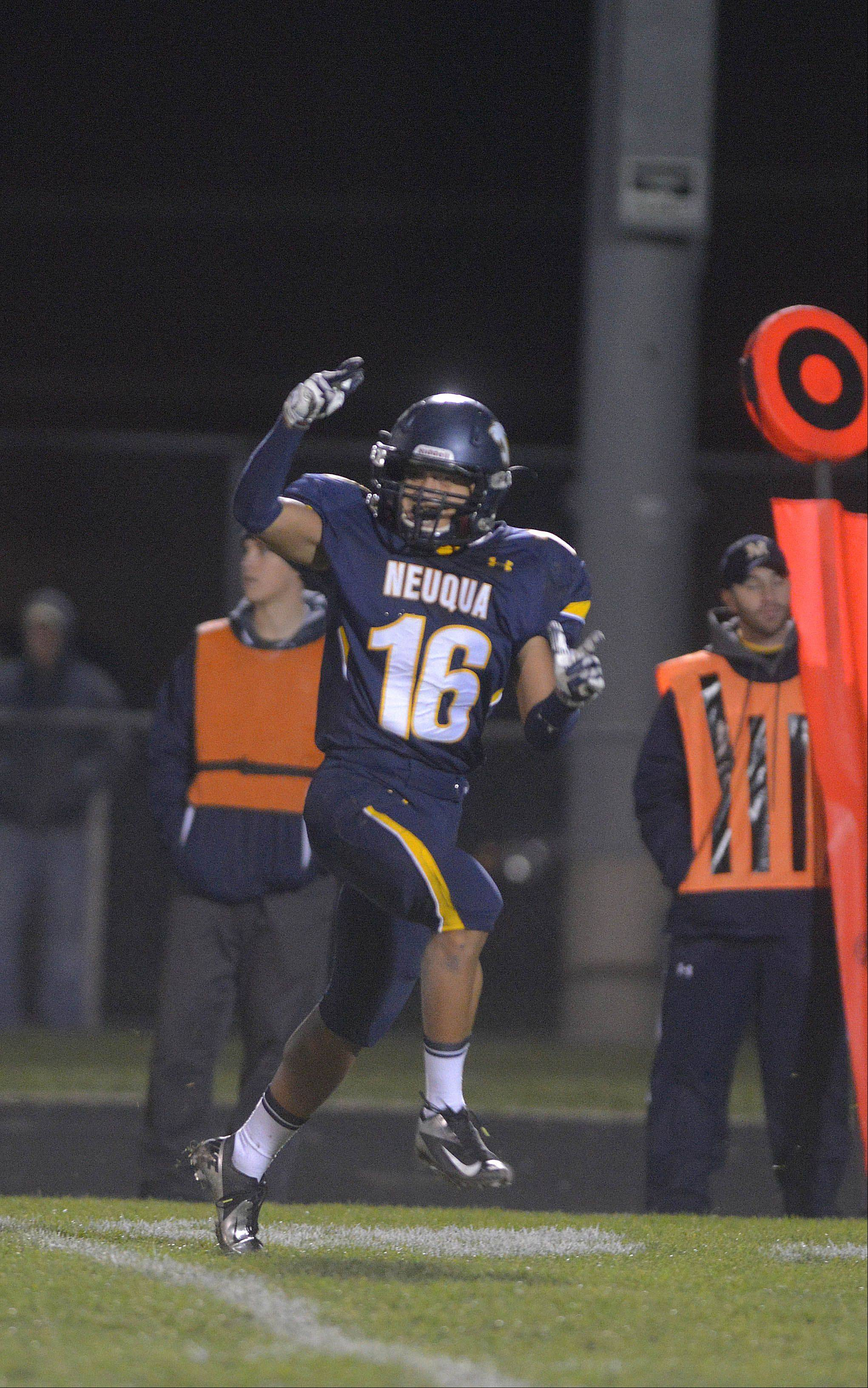 Neuqua Valley's Kyle Boonyong celebrates his team's win over Simeon Saturday in Naperville.