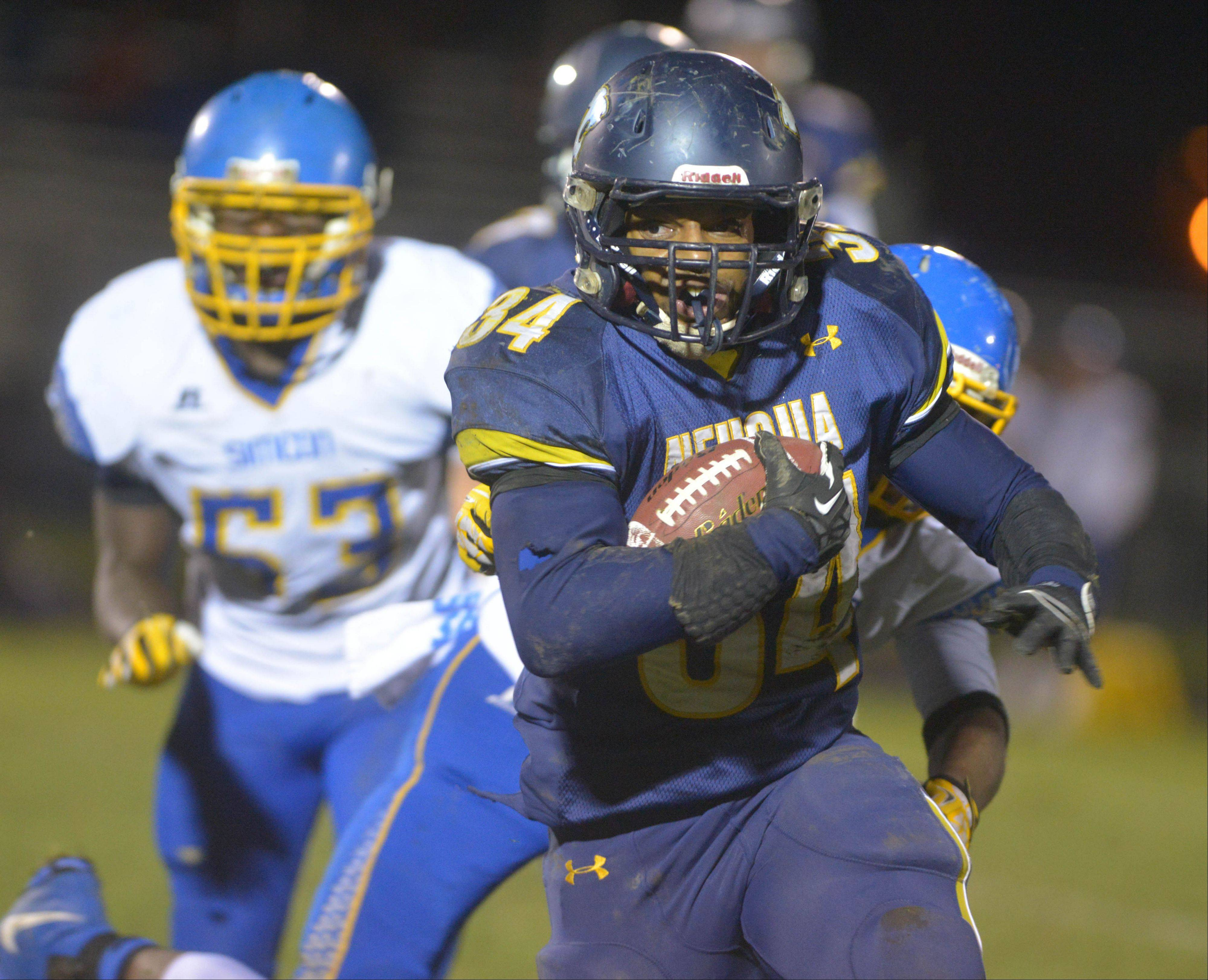 Neuqua Valley's TJ Scruggs moves the ball against Simeon during Saturday's playoff game.