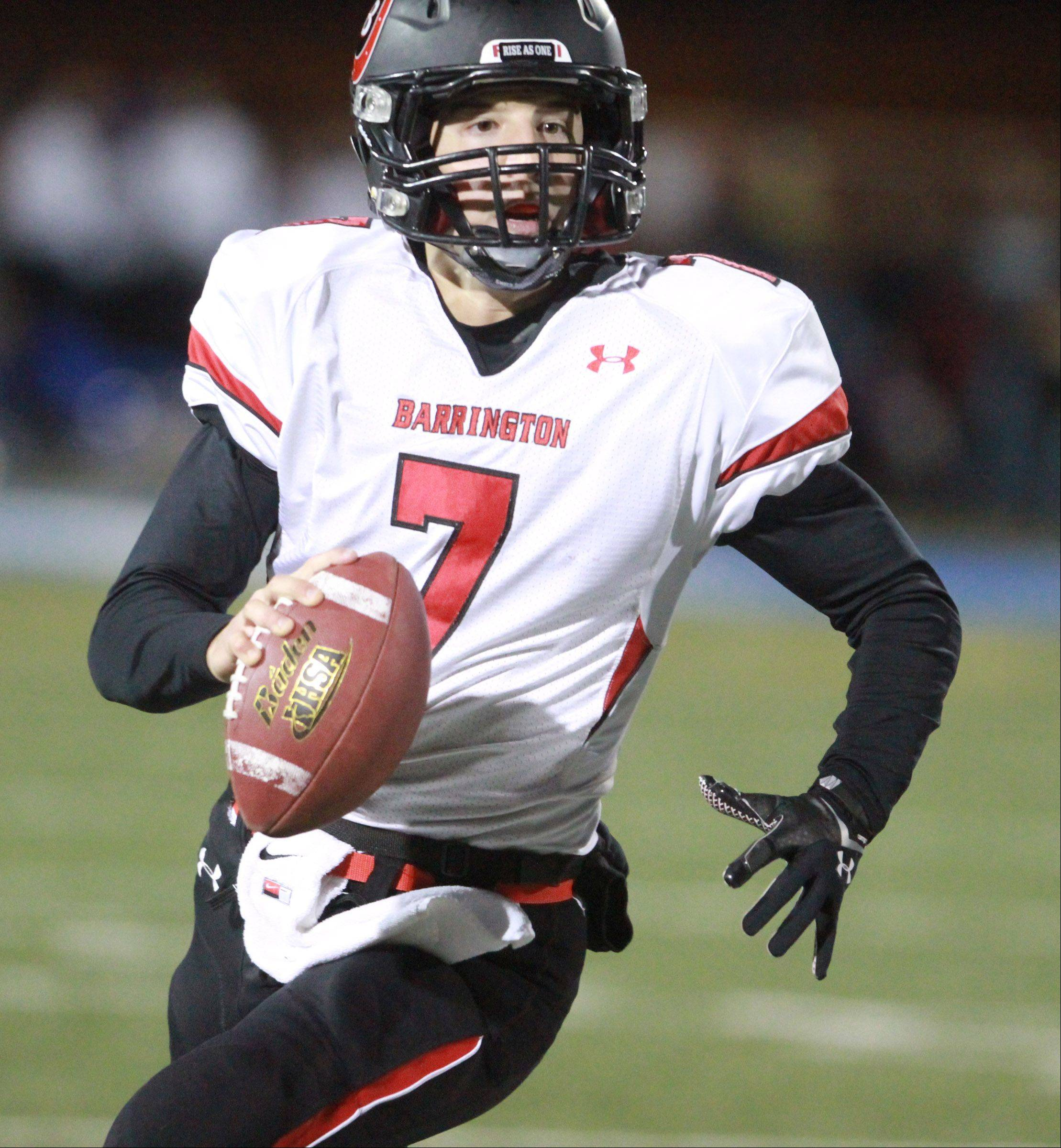Barrington quarterback Daniel Kubluk looks for a receiver during Saturday's playoff game against Warren.