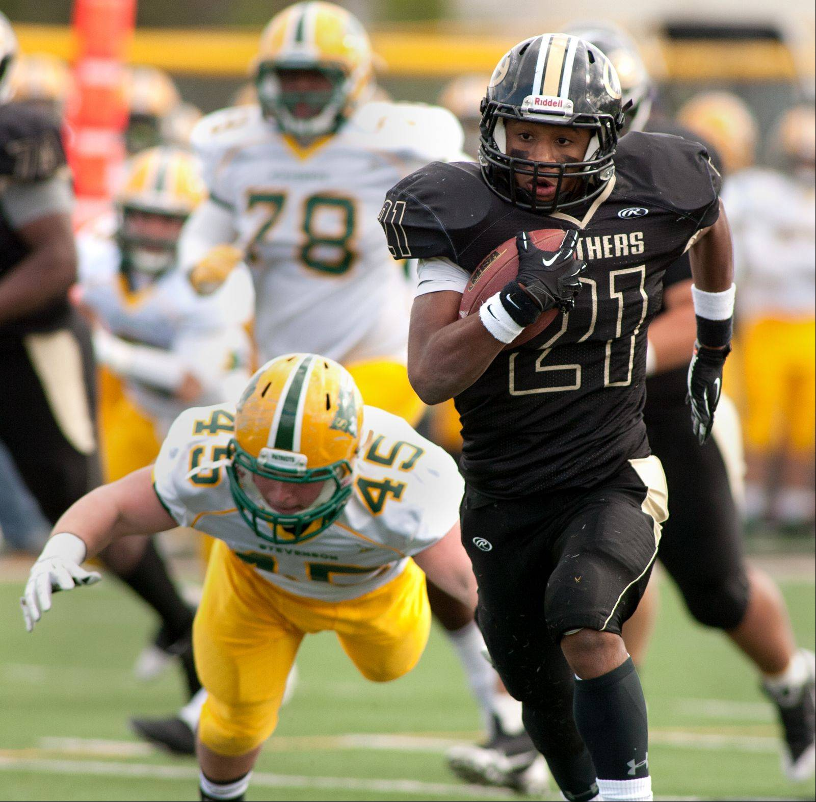 Glenbard North's Justin Jackson eyes the end zone on a 47-yard touchdown run.