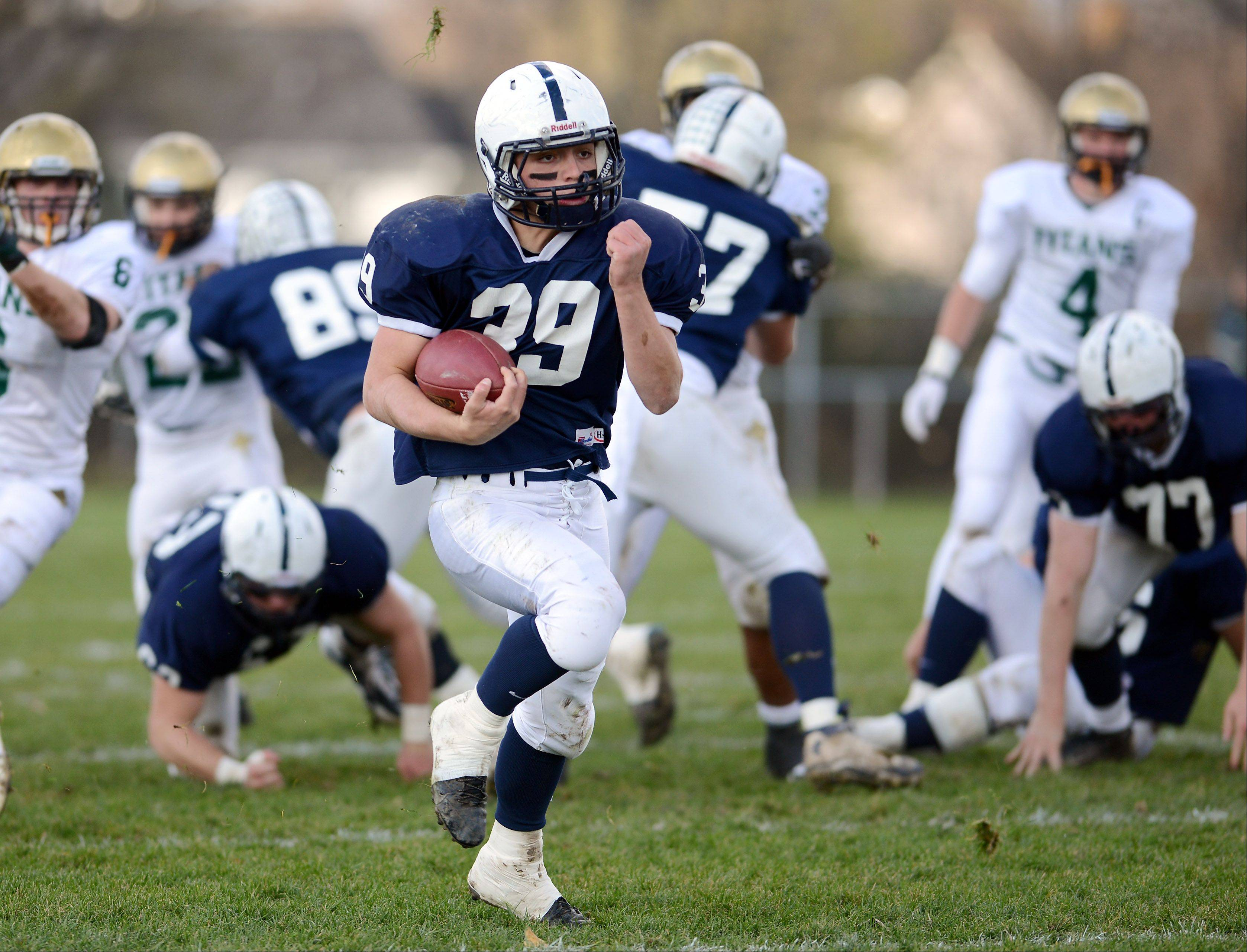 Cary-Grove's Tyler Pennington (39) breaks a long run against Boylan Catholic during Saturday's game in Cary.