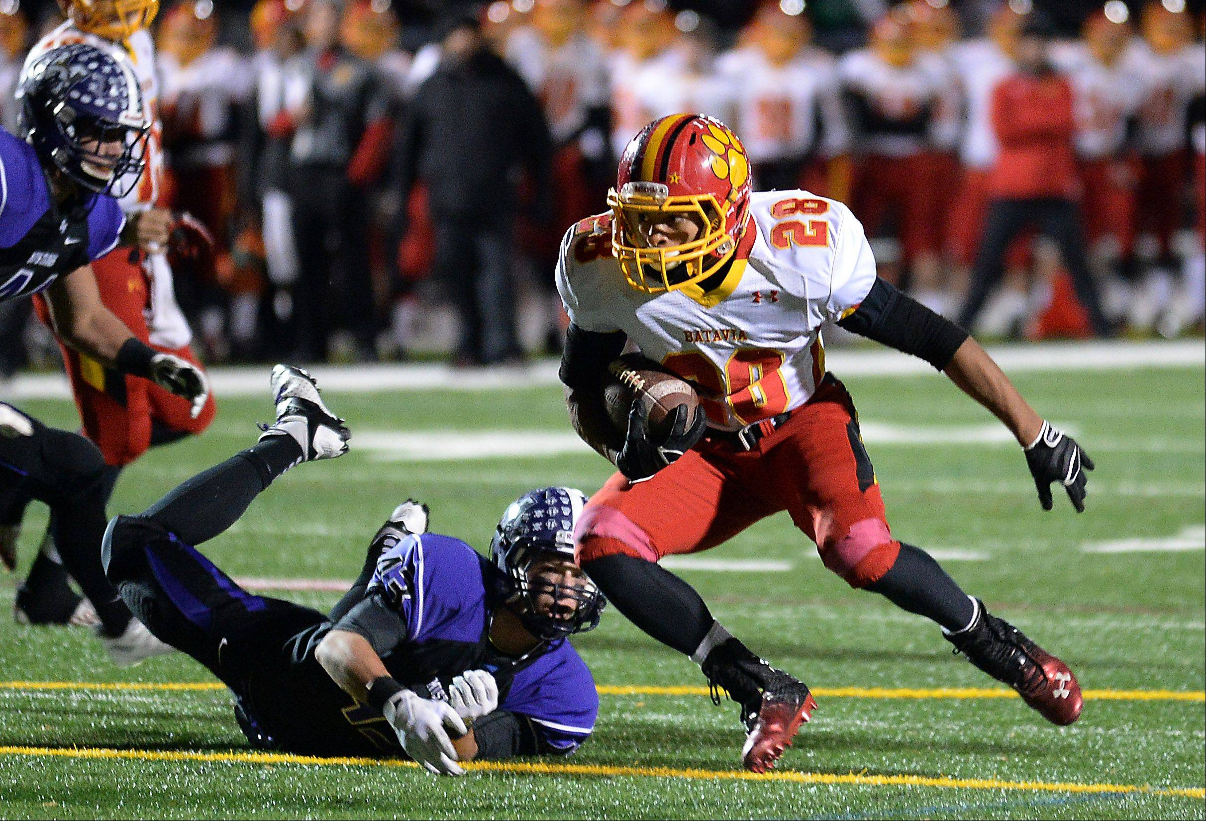 Batavia's Anthony Scaccia runs past Rolling Meadows' Peyton Dezonna in the third quarter for a touchdown.