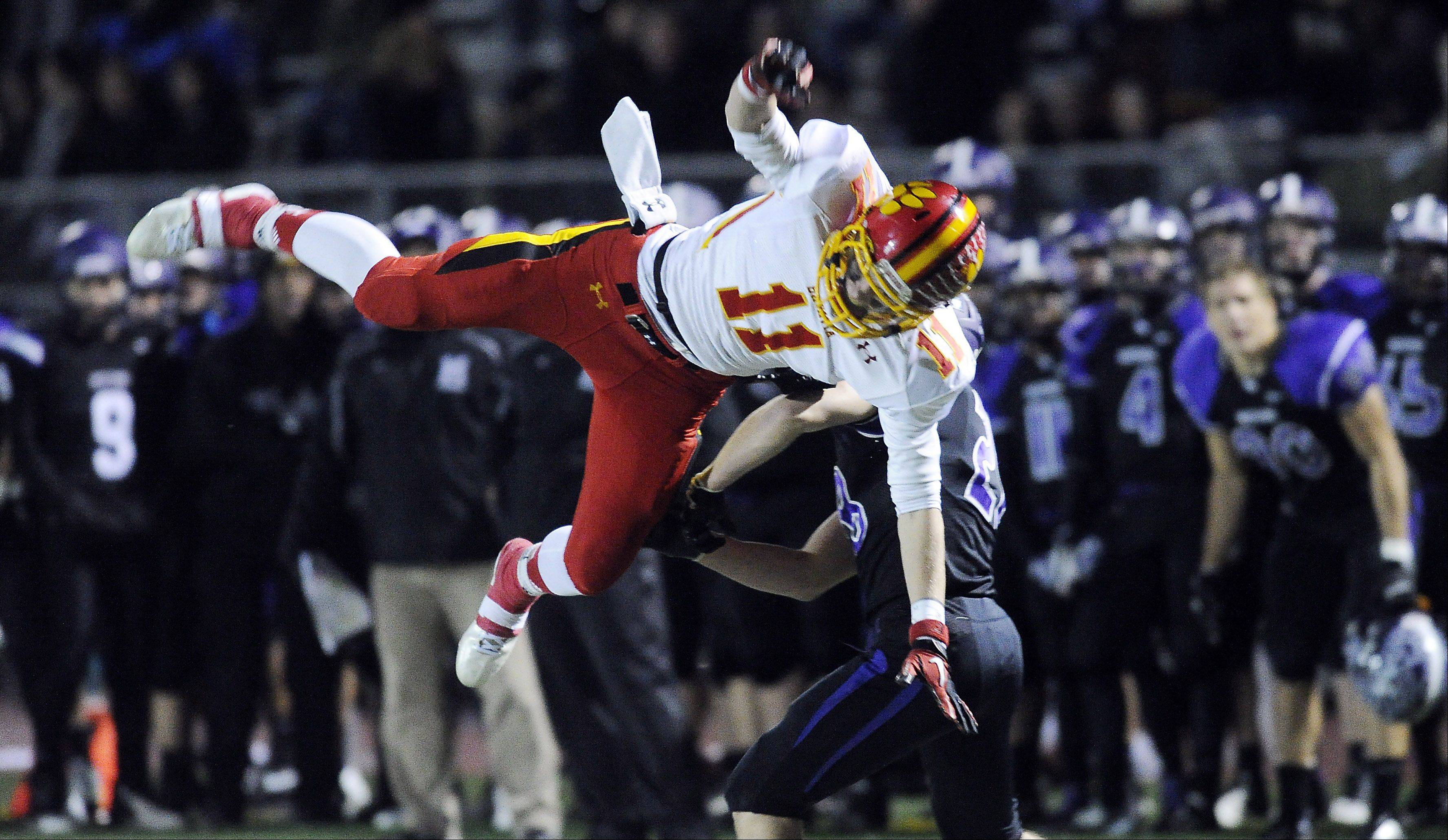 Batavia's Tucker Knox breaks up a pass play intended for Rolling Meadows' Calvin Gunn.