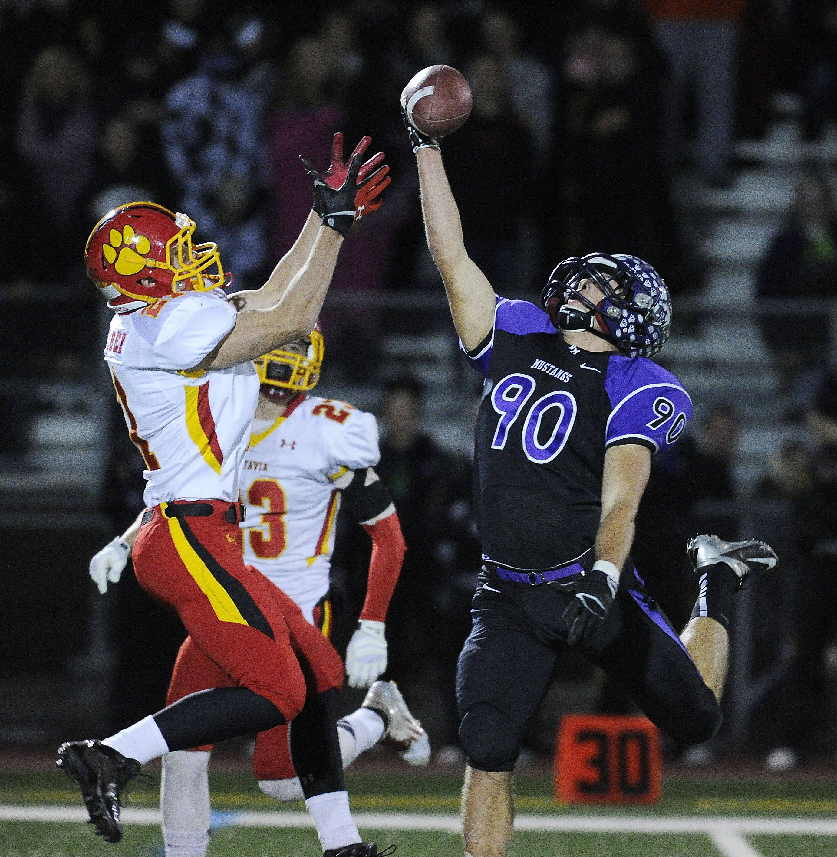 Batavia's Nick Bernabei is unable to stop this one-handed pass play that Rolling Meadows' Matt Campbell grabbed and ran in for a touchdown in the second quarter.