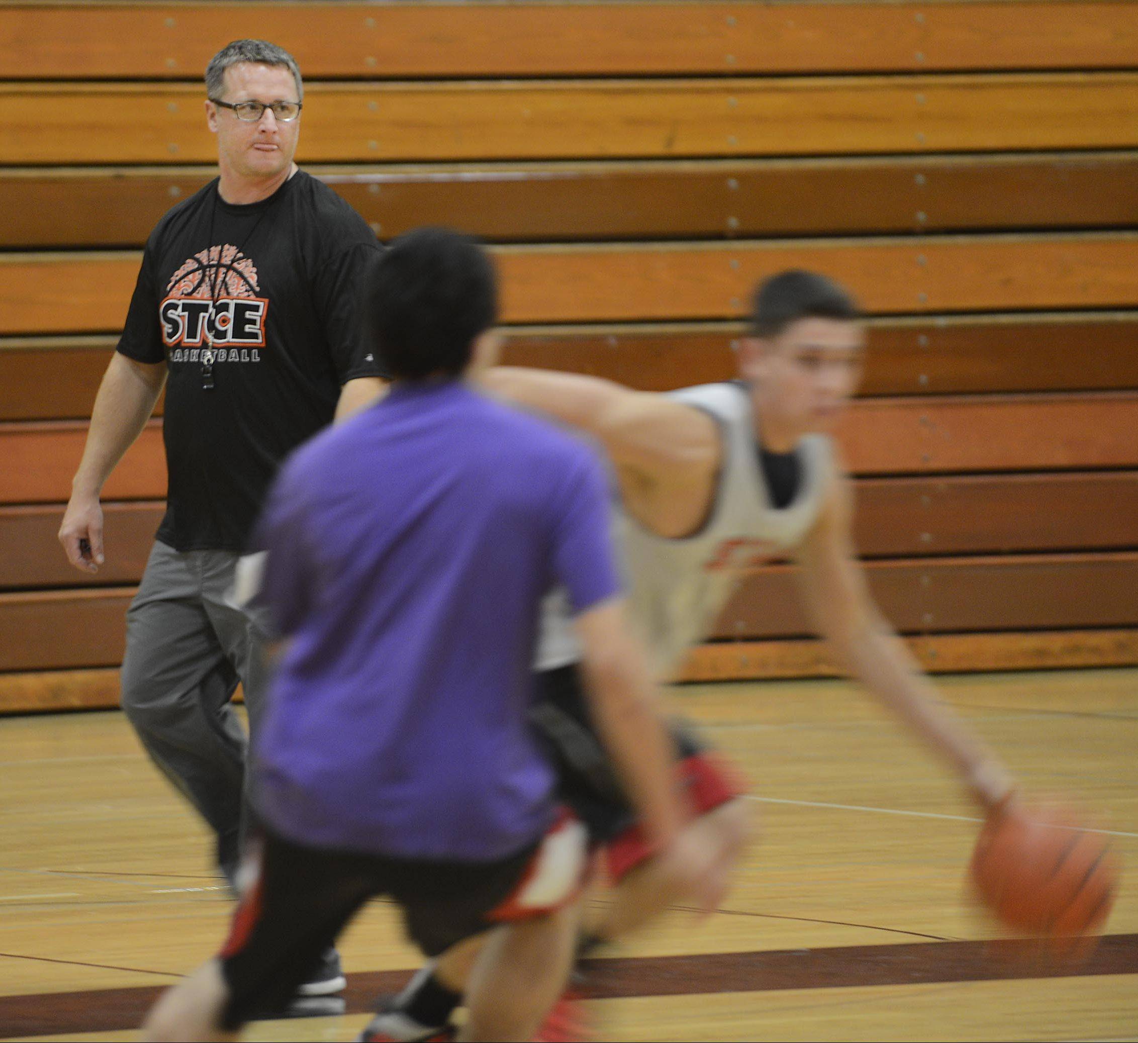 St. Charles East boys basketball coach Patrick Woods watches his players during the first day of practice Monday.