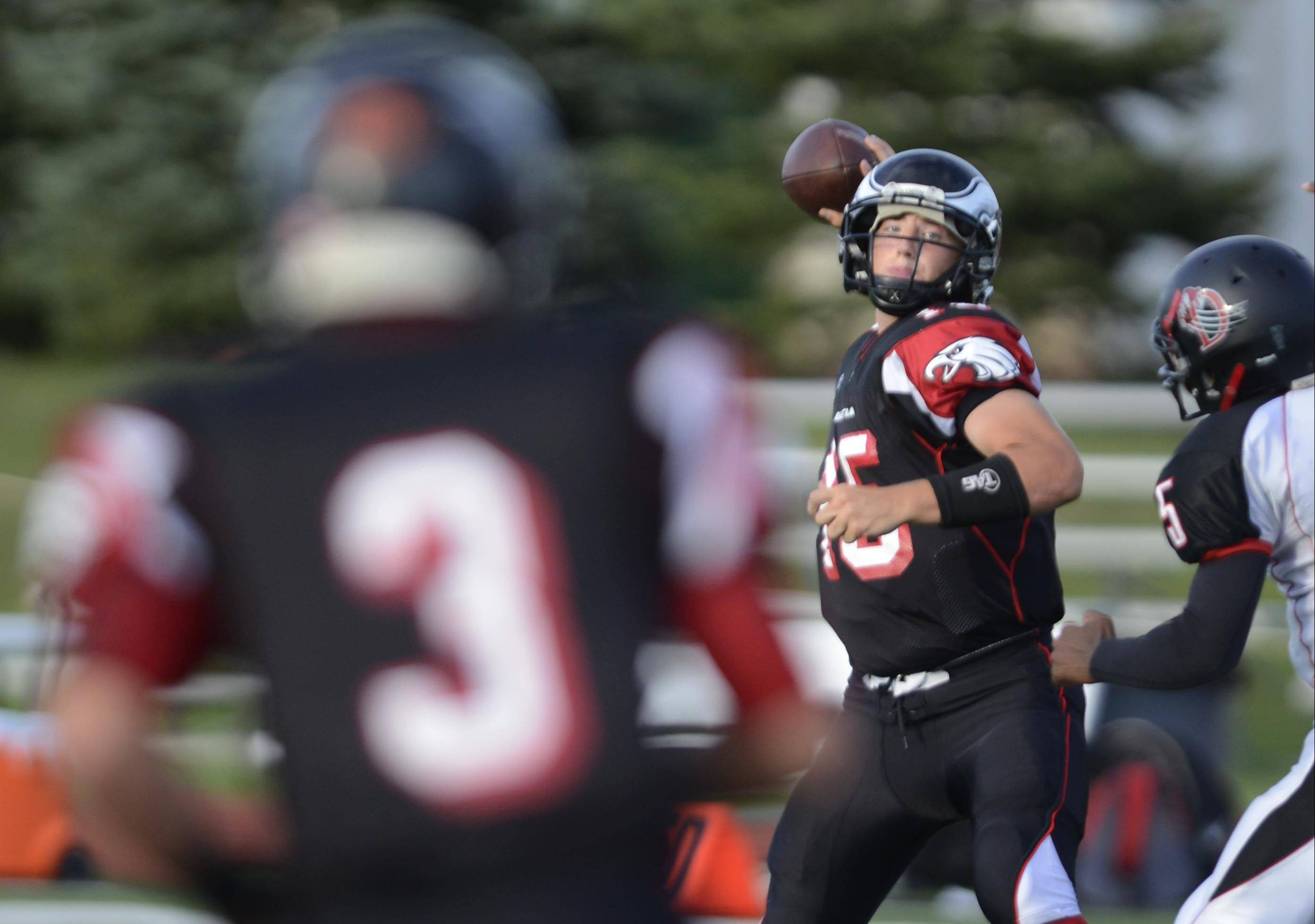 Aurora Christian quarterback Austin Bray, pictured earlier this season throwing a pass to wide receiver Brandon Walgren, completed 8 of 11 passes last week against Oregon for 238 yards, 3 touchdowns and no interceptions. He also ran for a score.