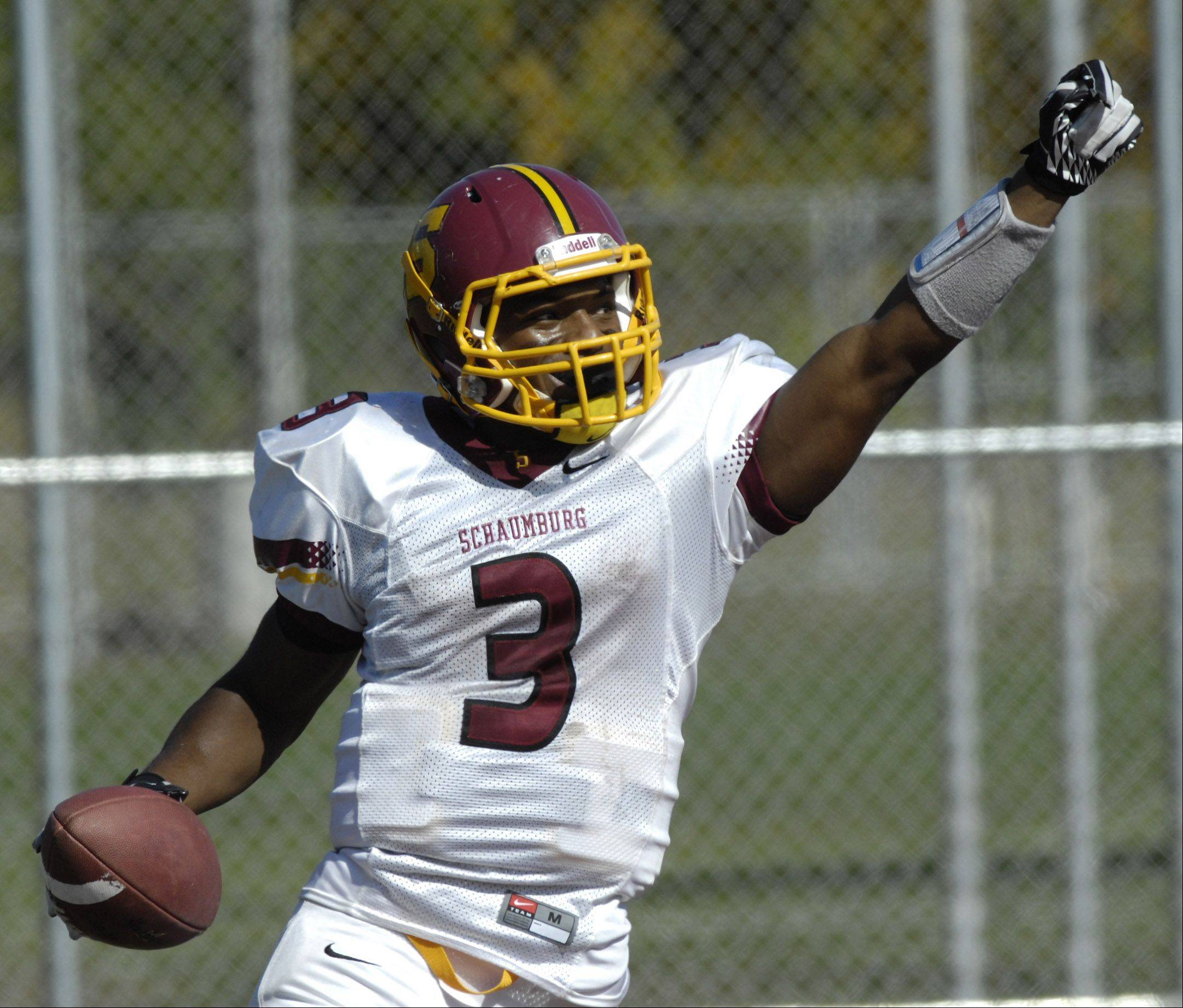 Schaumburg's Sadarriss Patterson celebrates his second-quarter touchdown in the Saxons' key MSL West victory over Barrington.