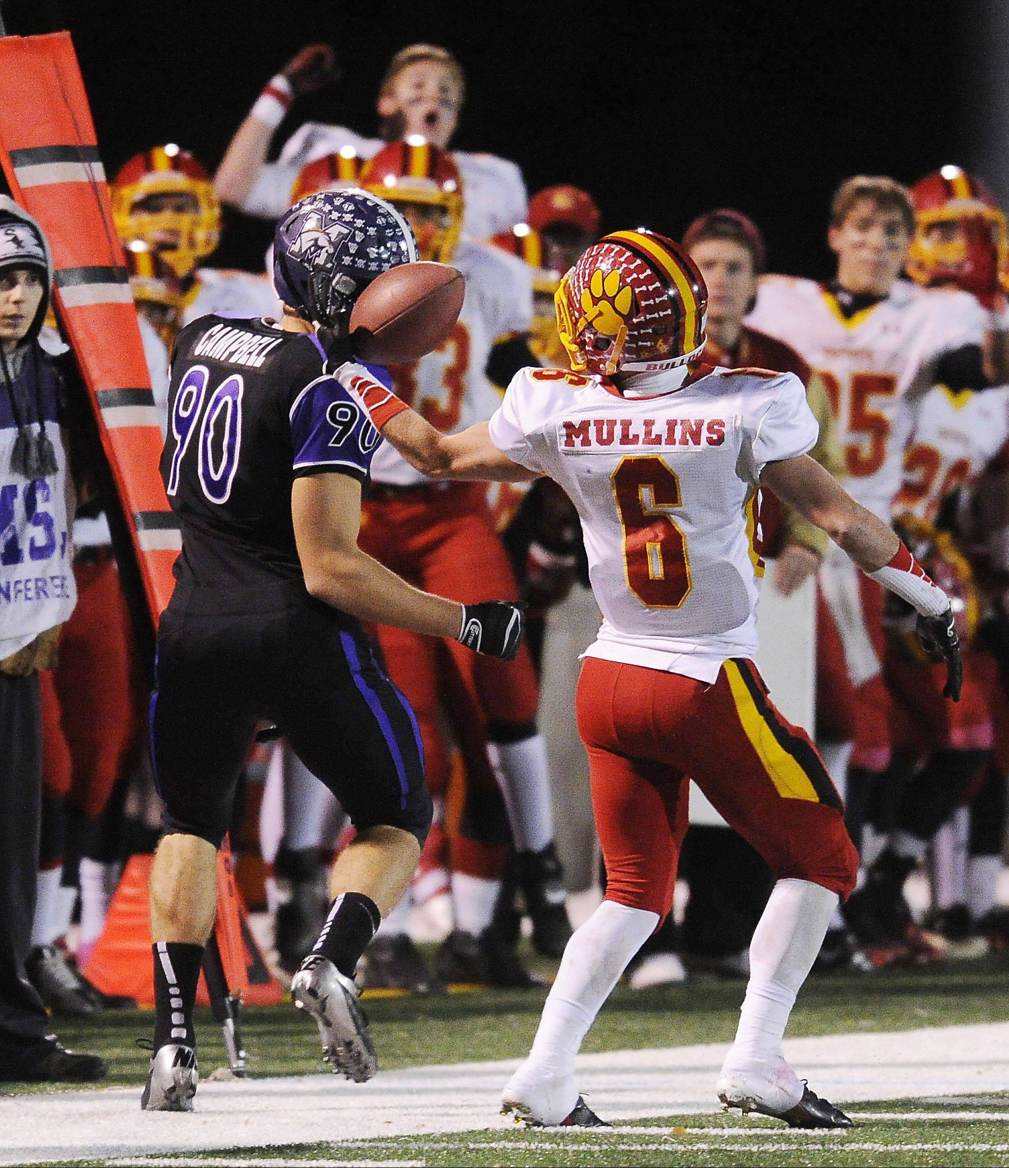 Batavia's Rouke Mullins takes the ball away from Rolling Meadows' Matt Campbell for an interception in the second quarter of the second round of the Class 6A playoffs at Rolling Meadows last Saturday.