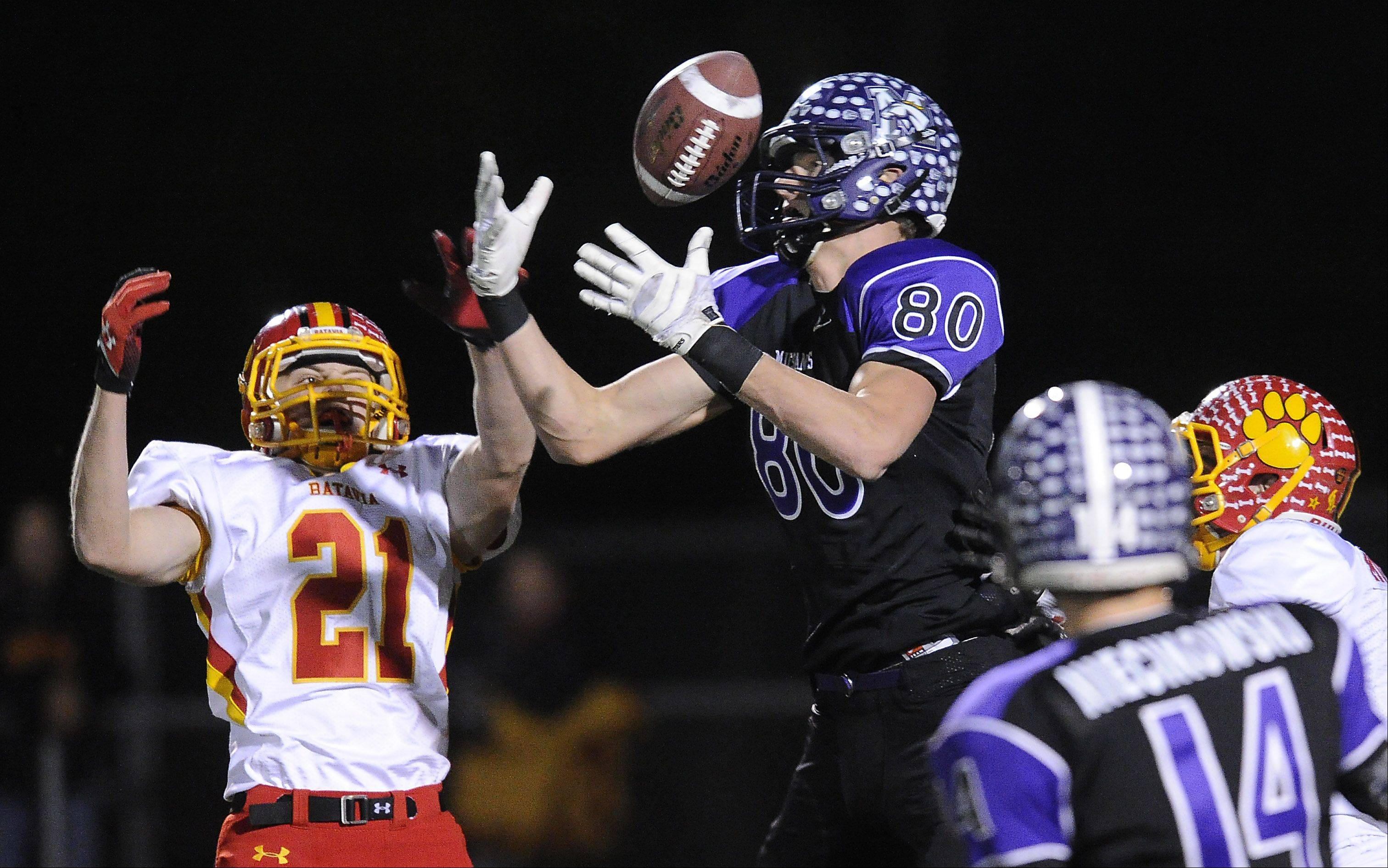 Mark Welsh/mwelsh@dailyherald.comBatavia's Nick Bernabei breaks up a pass intended for Rolling Meadows' Matt Dolan in the second quarter of the second-round game of the Class 6A playoffs at Rolling Meadows High School on Saturday.