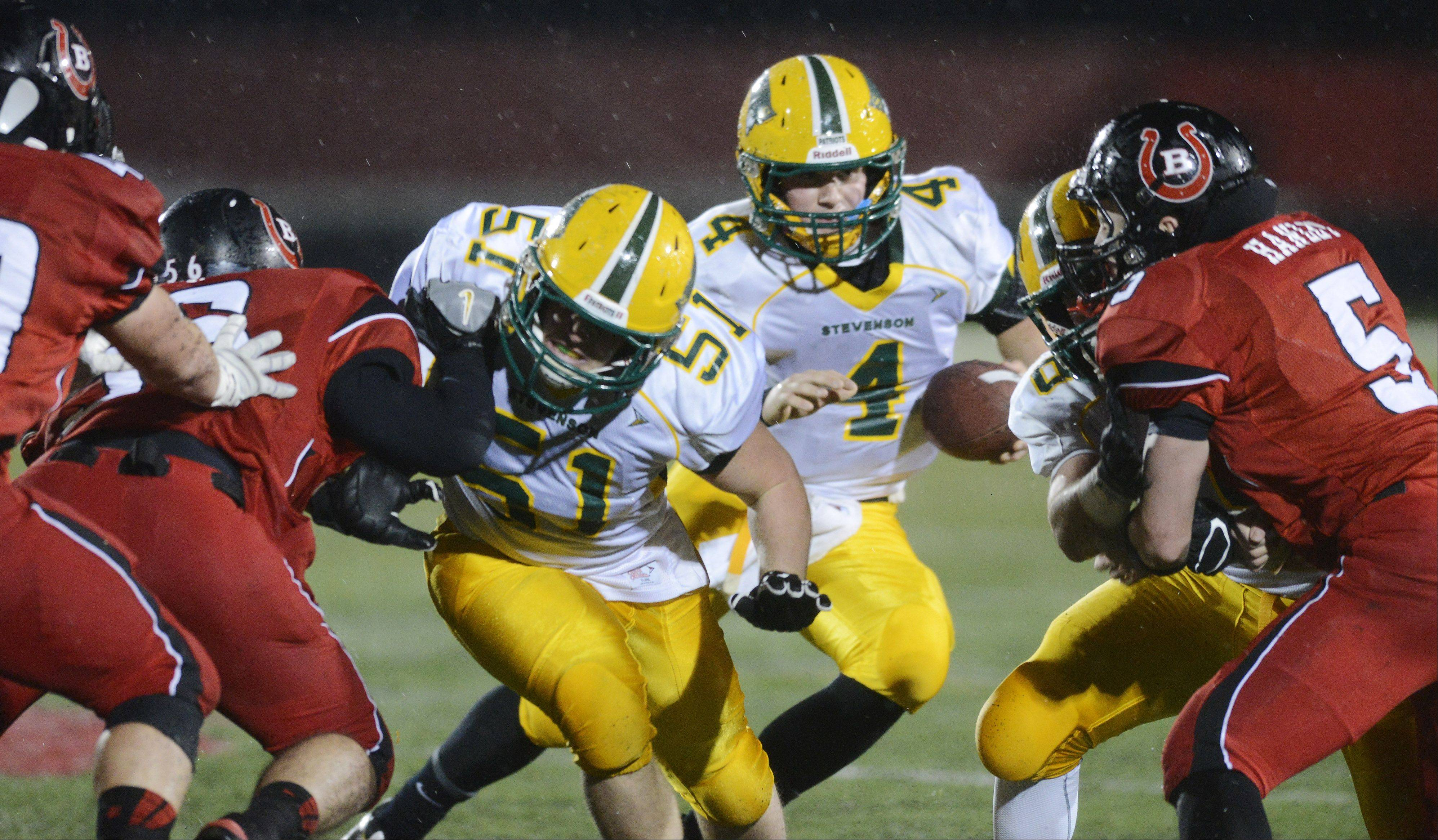Stevenson quarterback Willie Bourbon carries the ball during Saturday's Class 8A playoff game against Barrington.
