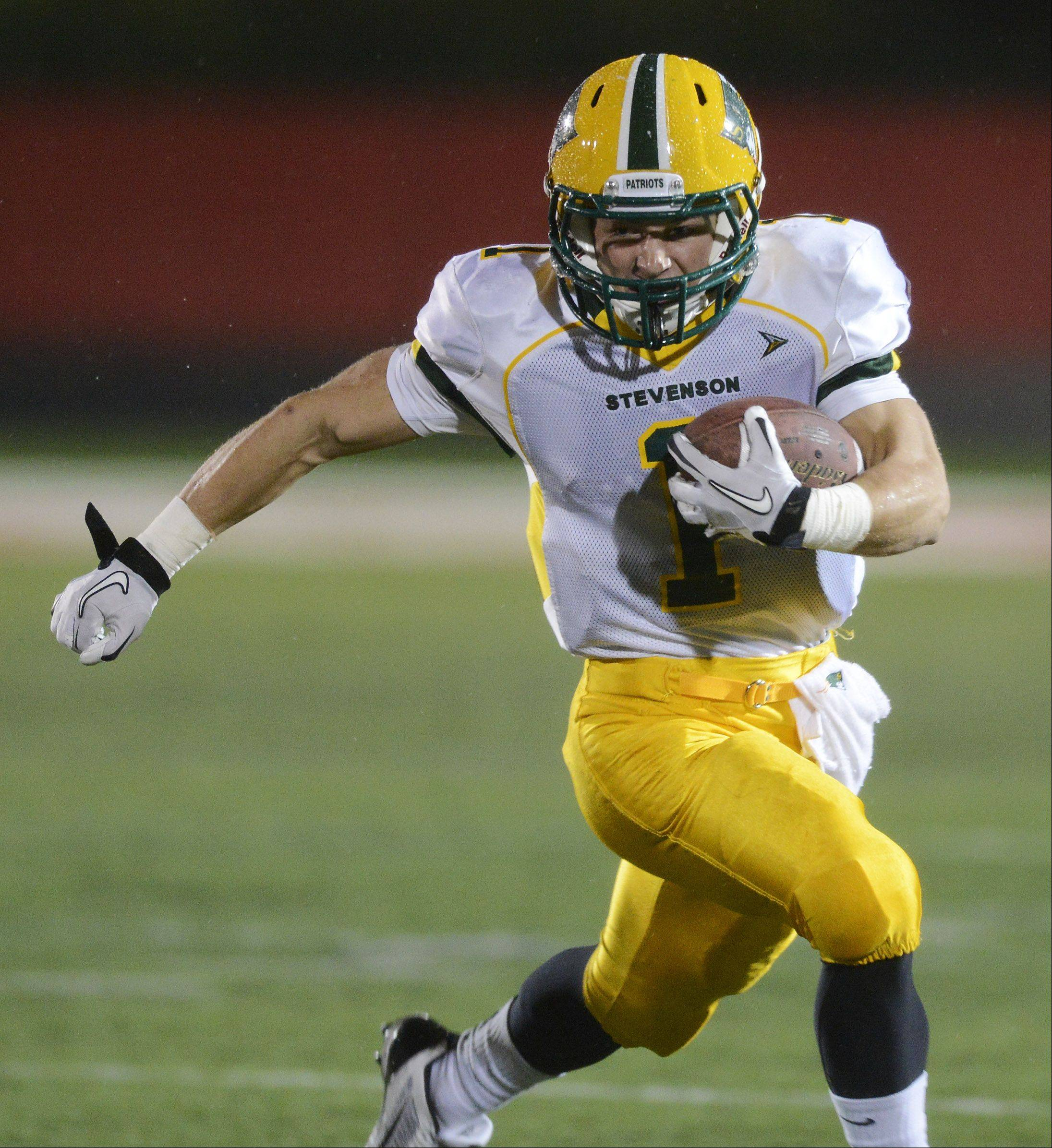 Stevenson's Conor Okmin carries the ball during Saturday's Class 8A playoff game against Barrington.