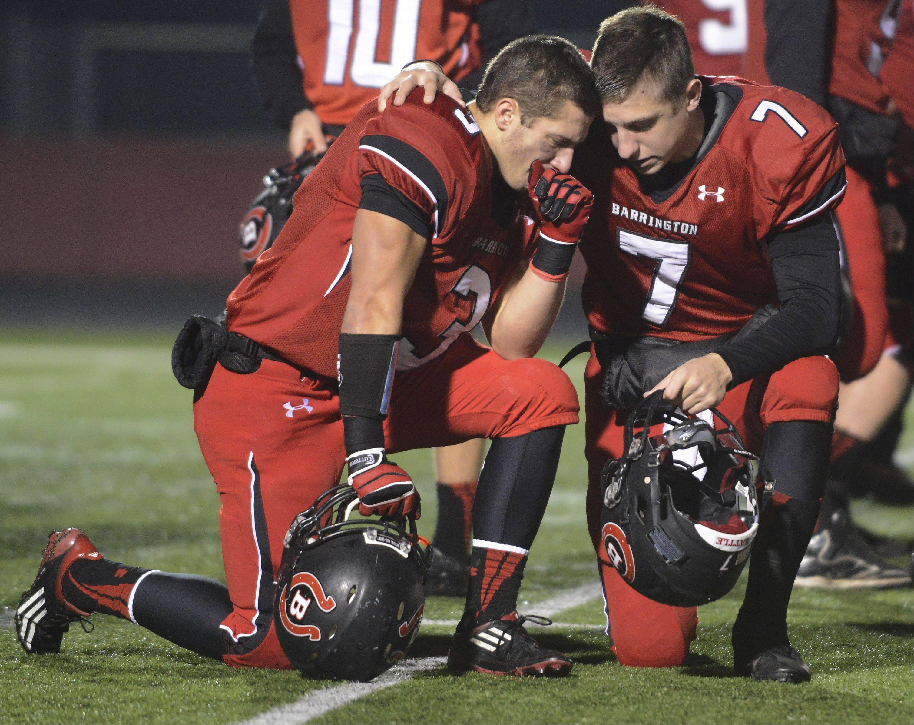 Barrington quarterback Daniel Kubiuk tries to console teammate Tommy Lessing following the Broncos' 14-0 loss to Stevenson during Saturday's Class 8A playoff game.
