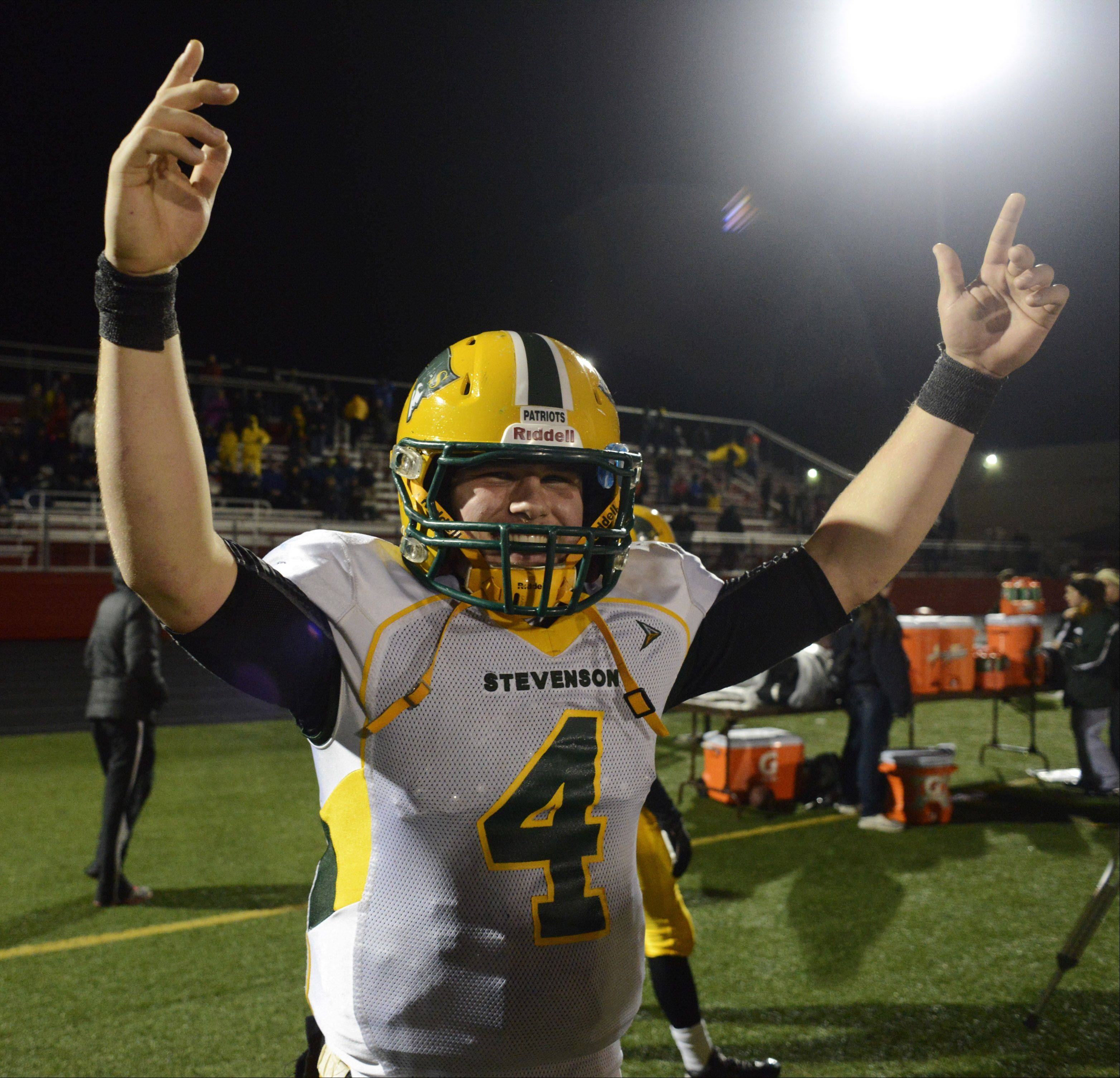 Stevenson quarterback Willie Bourbon celebrates as the clock winds down in the closing seconds of Saturday's 14-0 victory over Barrington.