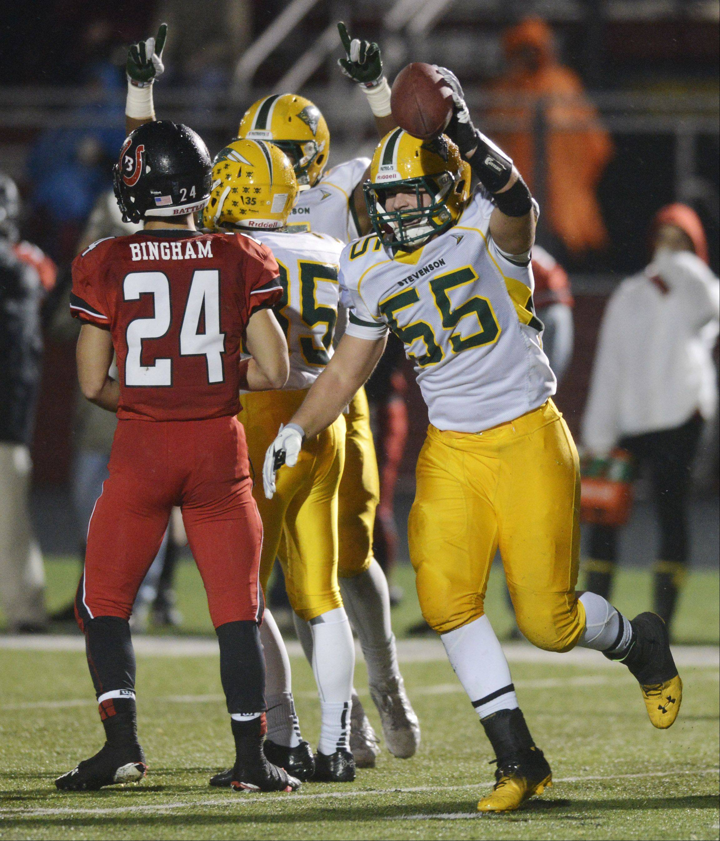 Stevenson's Jason Vravick celebrates a second-quarter interception during Saturday's Class 8A playoff football game against Barrington.