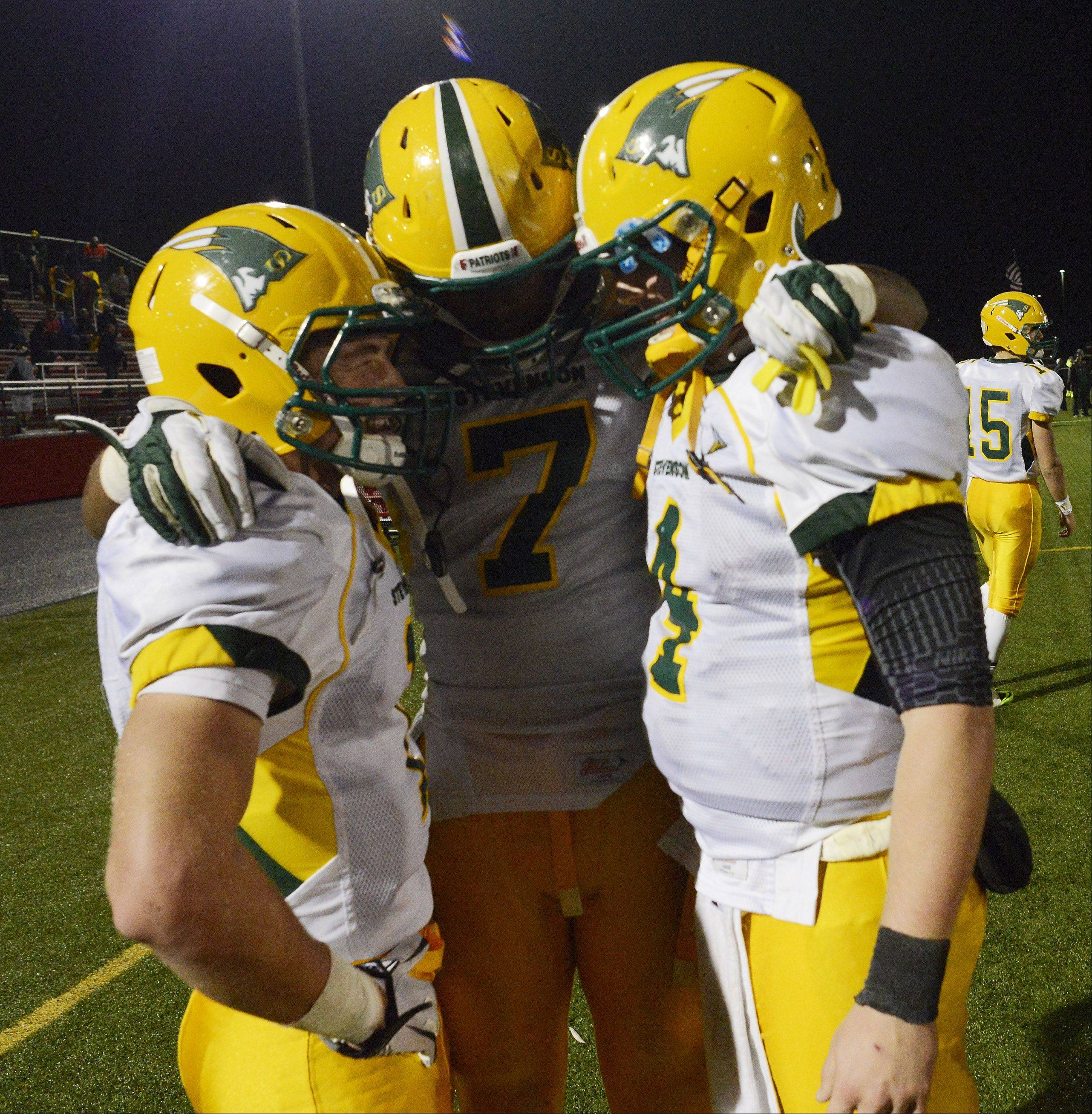 Stevenson's Conor Okmin, from left, Cameron Green and Willie Bourbon celebrate Saturday.