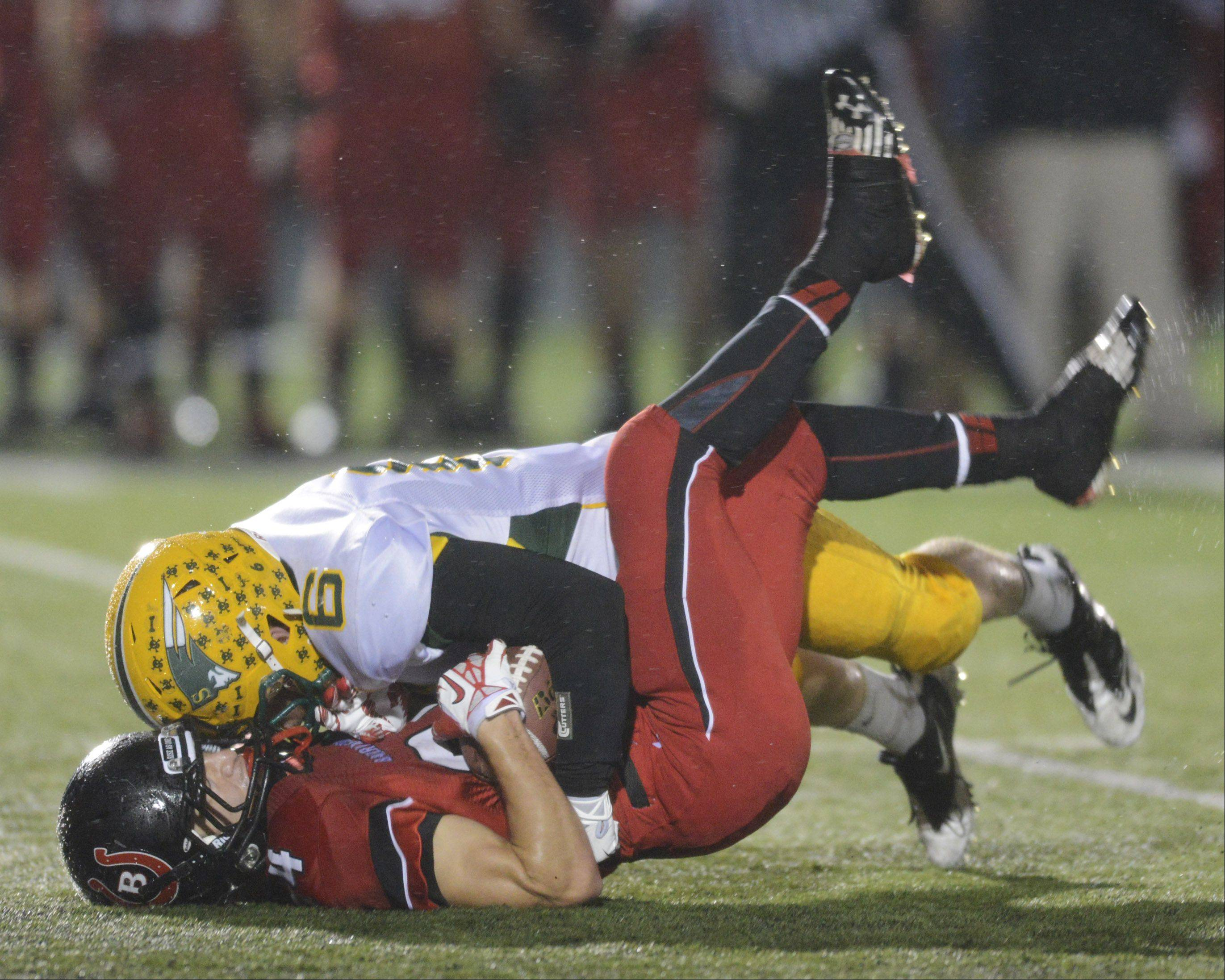 Barrington's Dylan Bingham, bottom, gets stopped by Stevenson's Itai Gerchikov Saturday in Barrington.