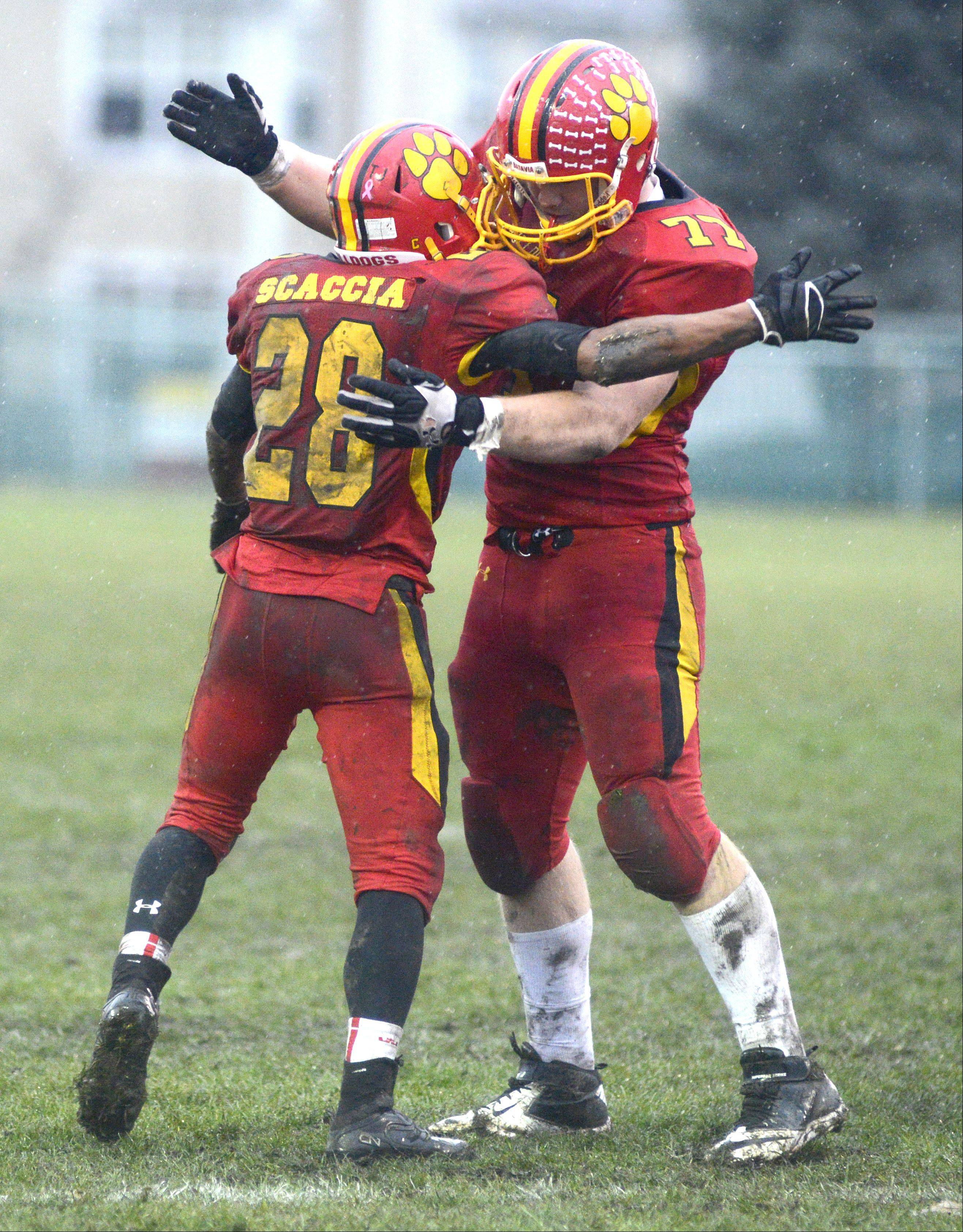 Batavia's Anthony Scaccia and Jack Breshears embrace on the field as the seconds tick down to their victory over Lake Forest in the Class 6A quarterfinal on Saturday, November 16.