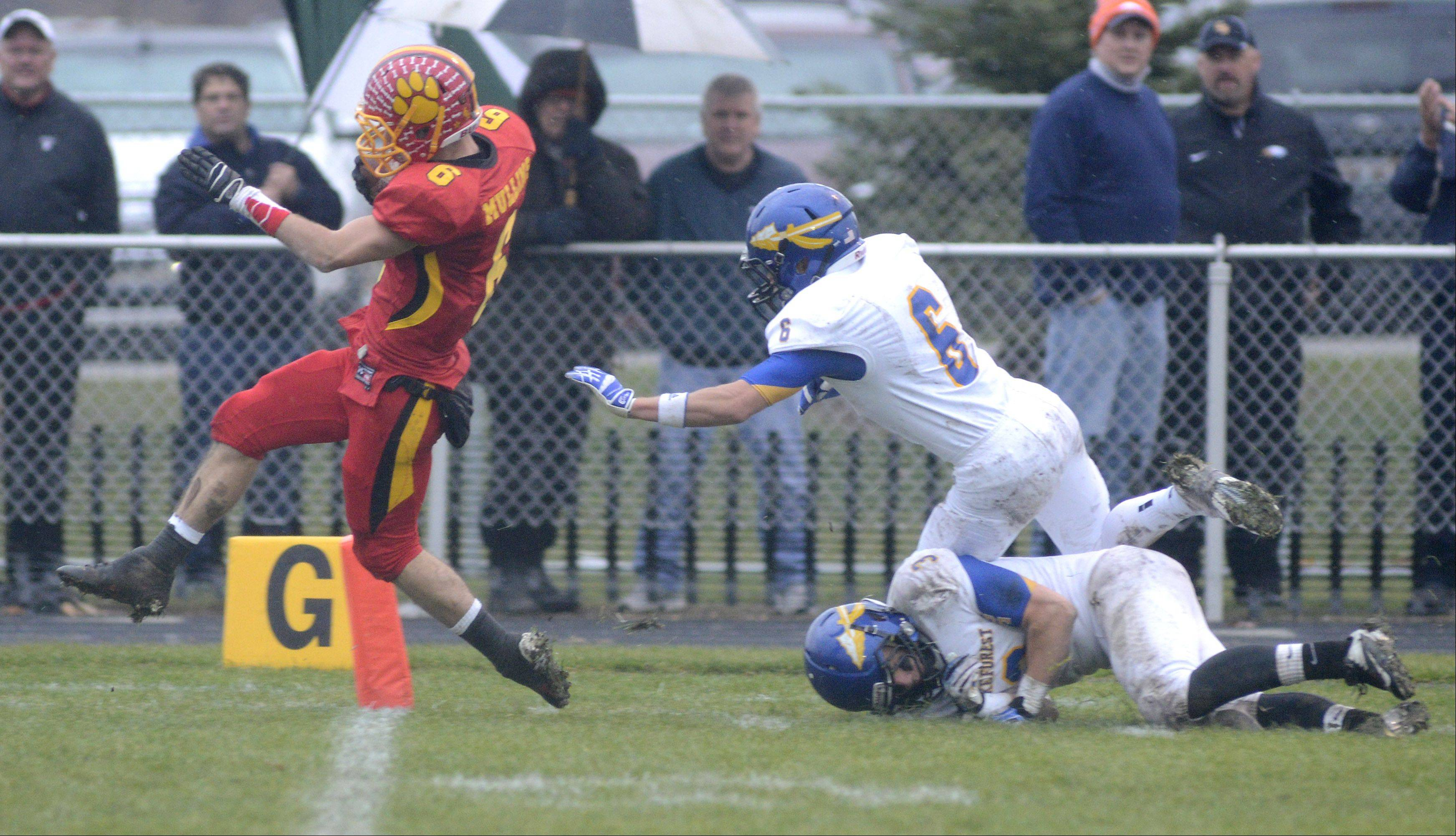 Batavia's Rourke Mullins skips over the goal line after shaking off Lake Forest's Andrew Nelson (6) and Jake Yale in the third quarter of the Class 6A quarterfinal on Saturday, November 16.