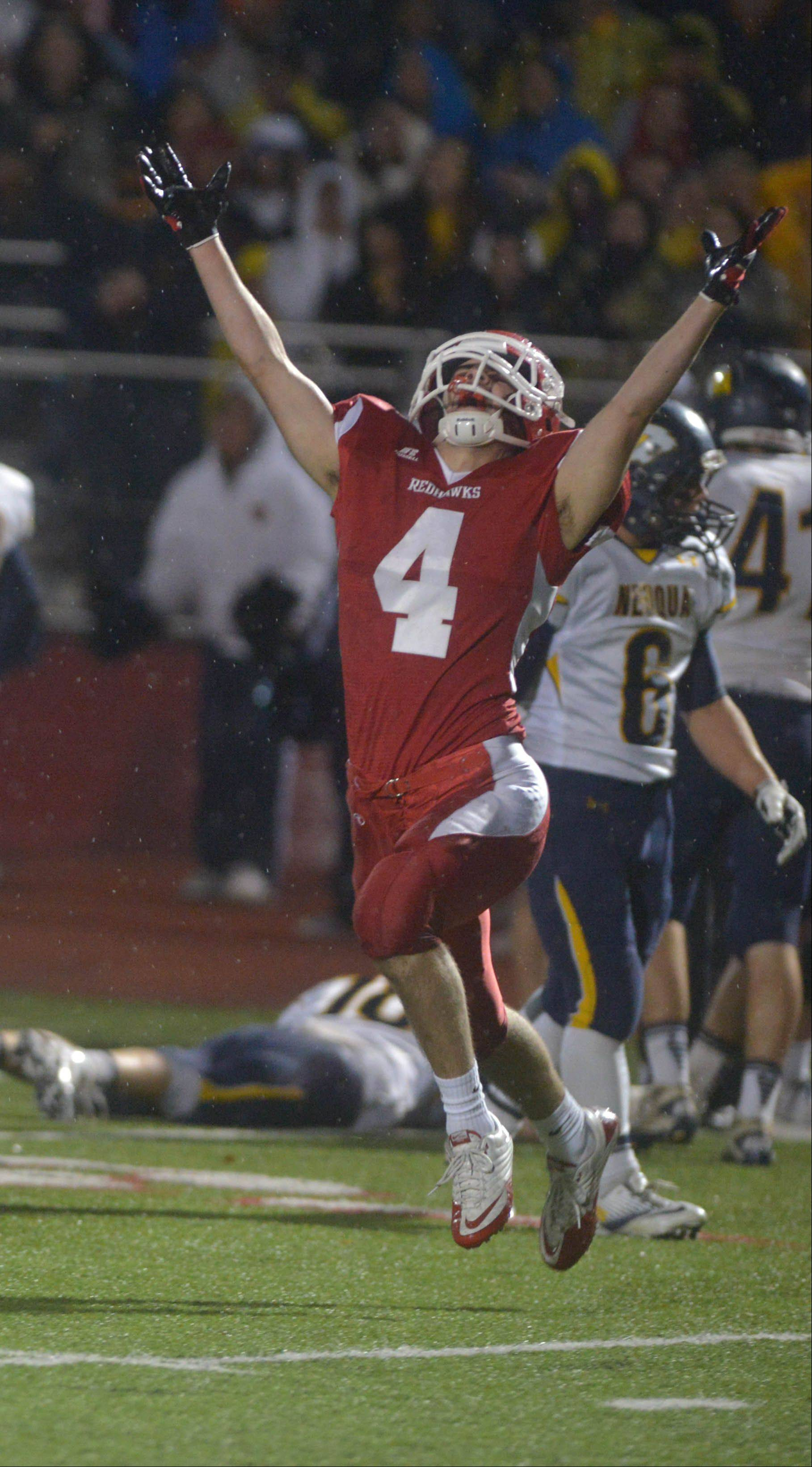 Naperville Central's Joe Nussbaum celebrates during Saturday's football playoff game against Neuqua Valley.