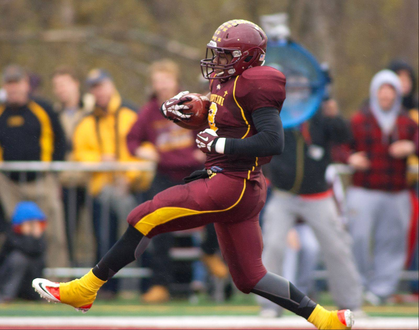 Montini Catholic's Niles Sykes (9) scampers into the endzone scoring a second half touchdown, against Joliet Catholic during Class 5A quarterfinal action in Lombard.