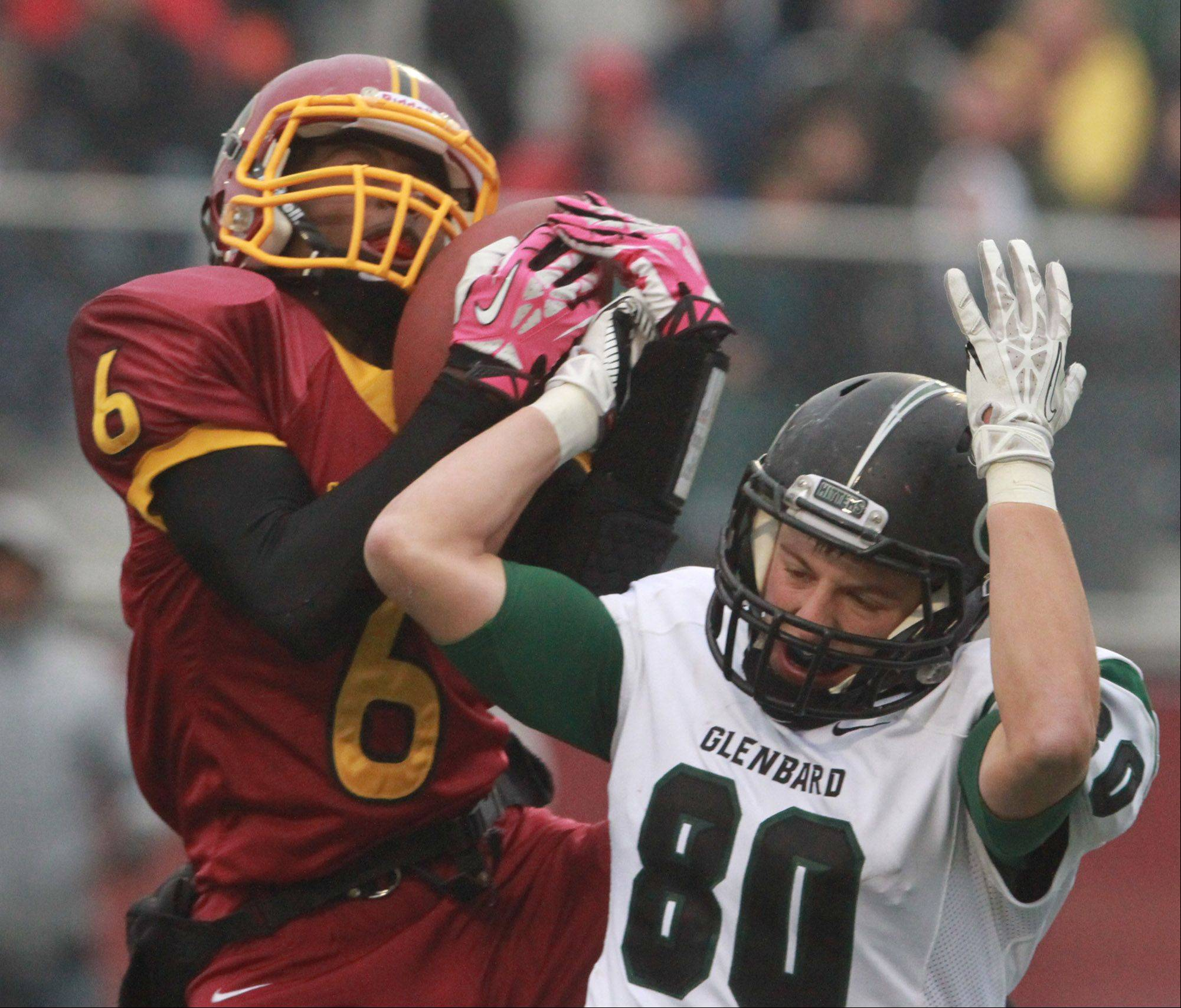Schaumburg defensive back Shandall Thomas intercepts a pass intended for Glenbard West receiver Luke Damask in a quarterfinal playoff game on Saturday in Schaumburg.
