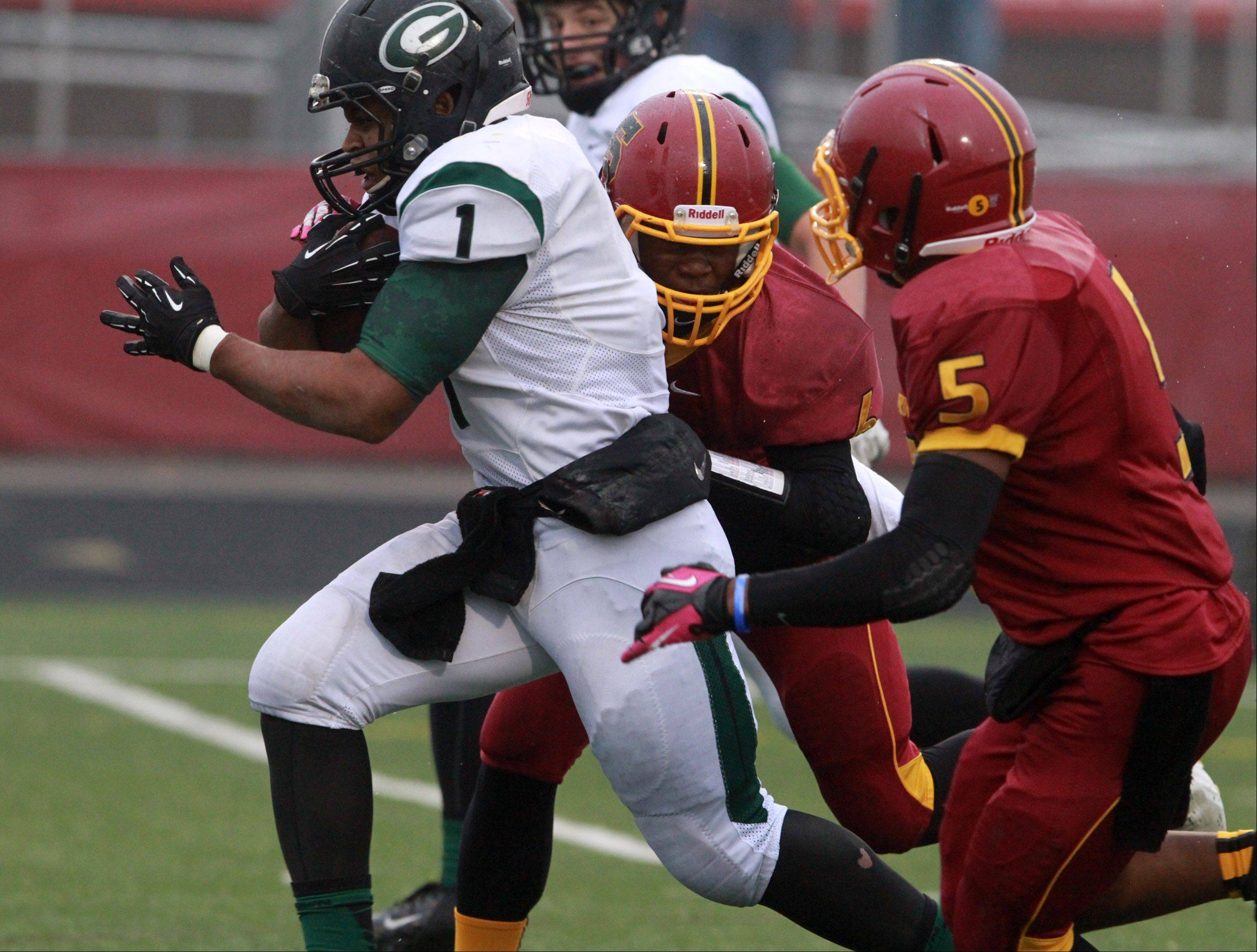 Schaumburg defender Rahsaan Green Jr. can't pull down Glenbard West running back Devonte Toney as he runs for a touch down in a quarterfinal playoff game on Saturday in Schaumburg.