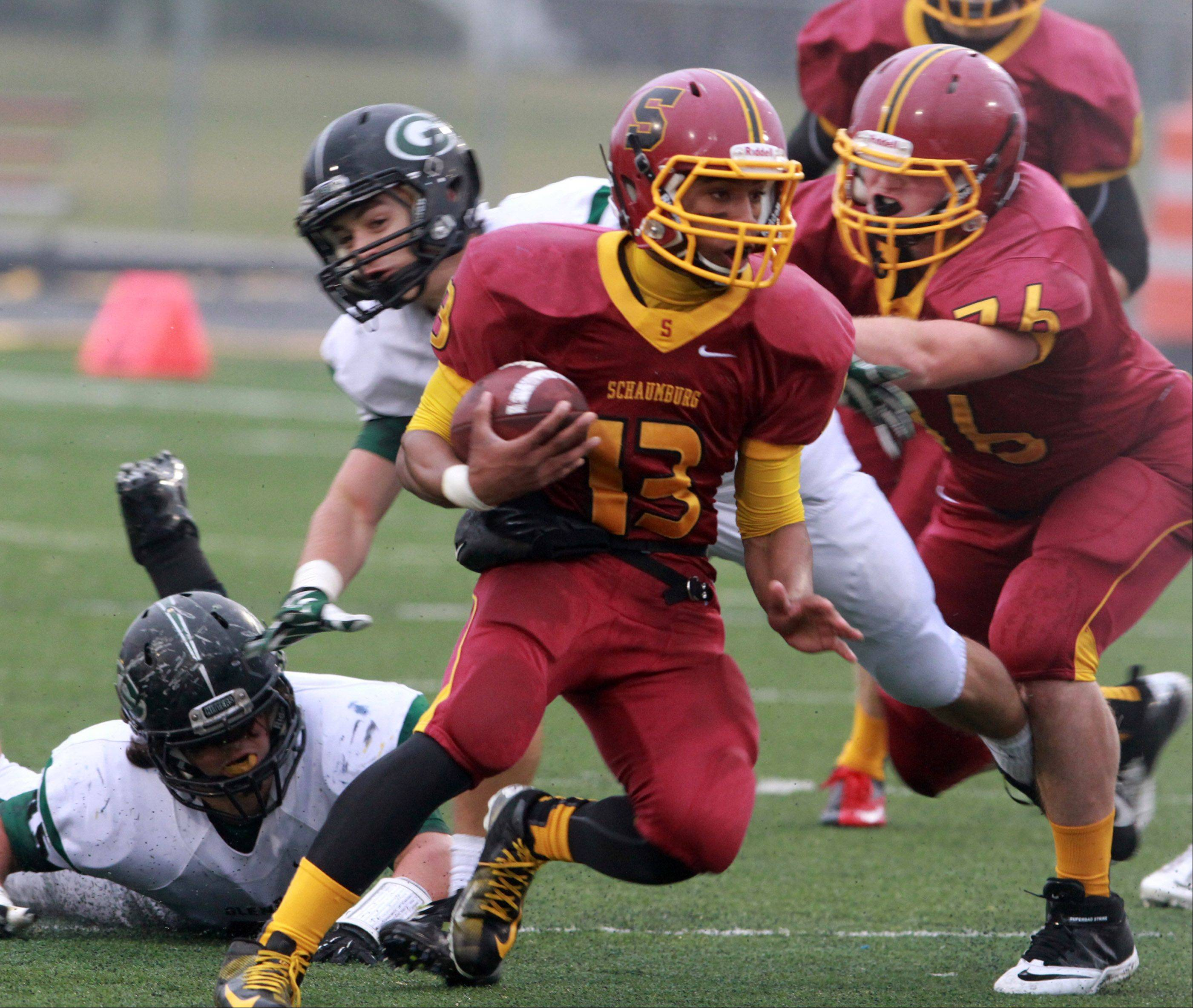 Schaumburg quarterback Stacey Smith runs the ball against Glenbard West in a quarterfinal playoff game on Saturday in Schaumburg.