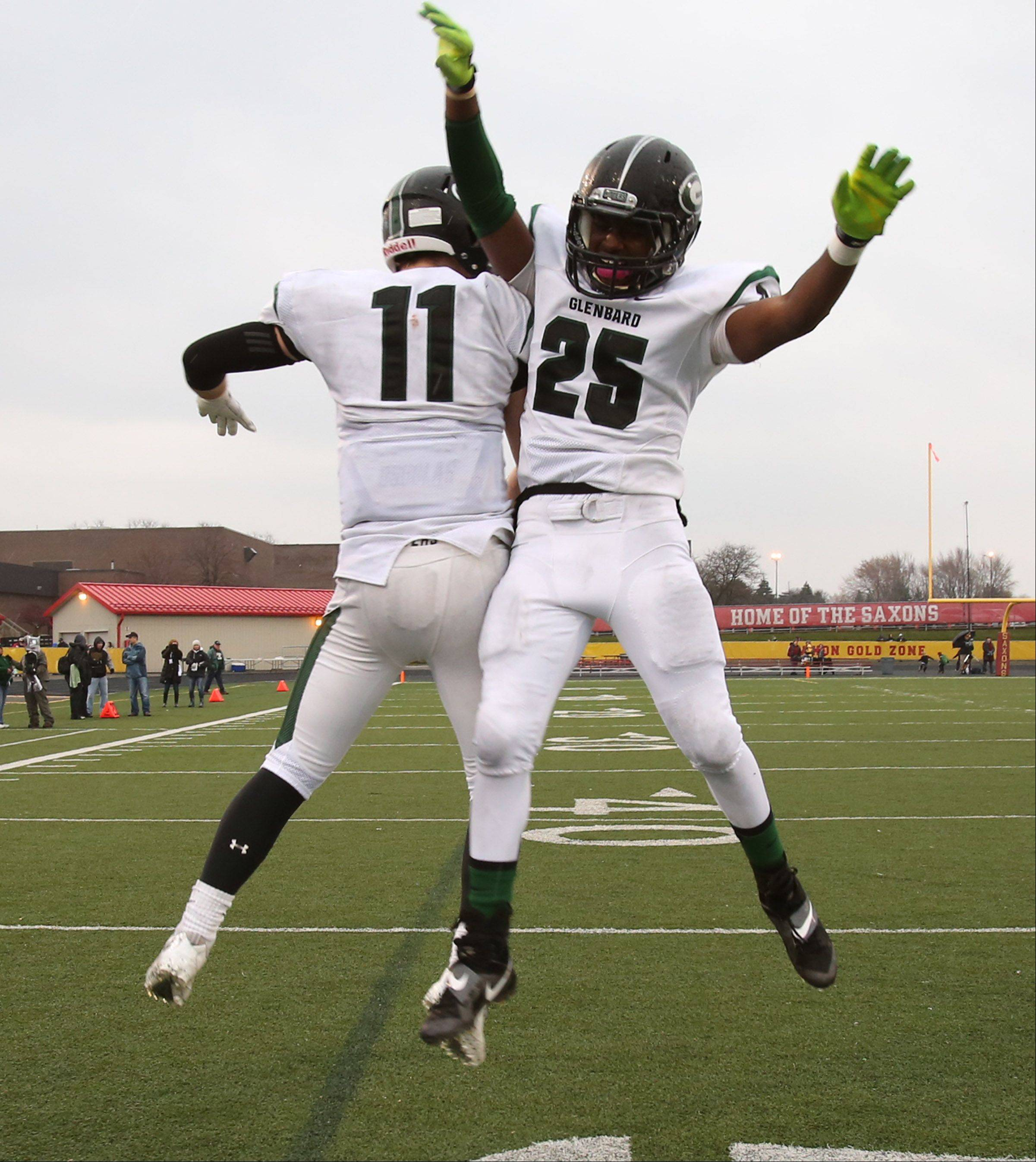Glenbard West Grant Greeno, left, and Jordon Andrews celebrate as the clock expires as Glenbard West wins 42-21 over Schaumburg in a quarterfinal playoff game.